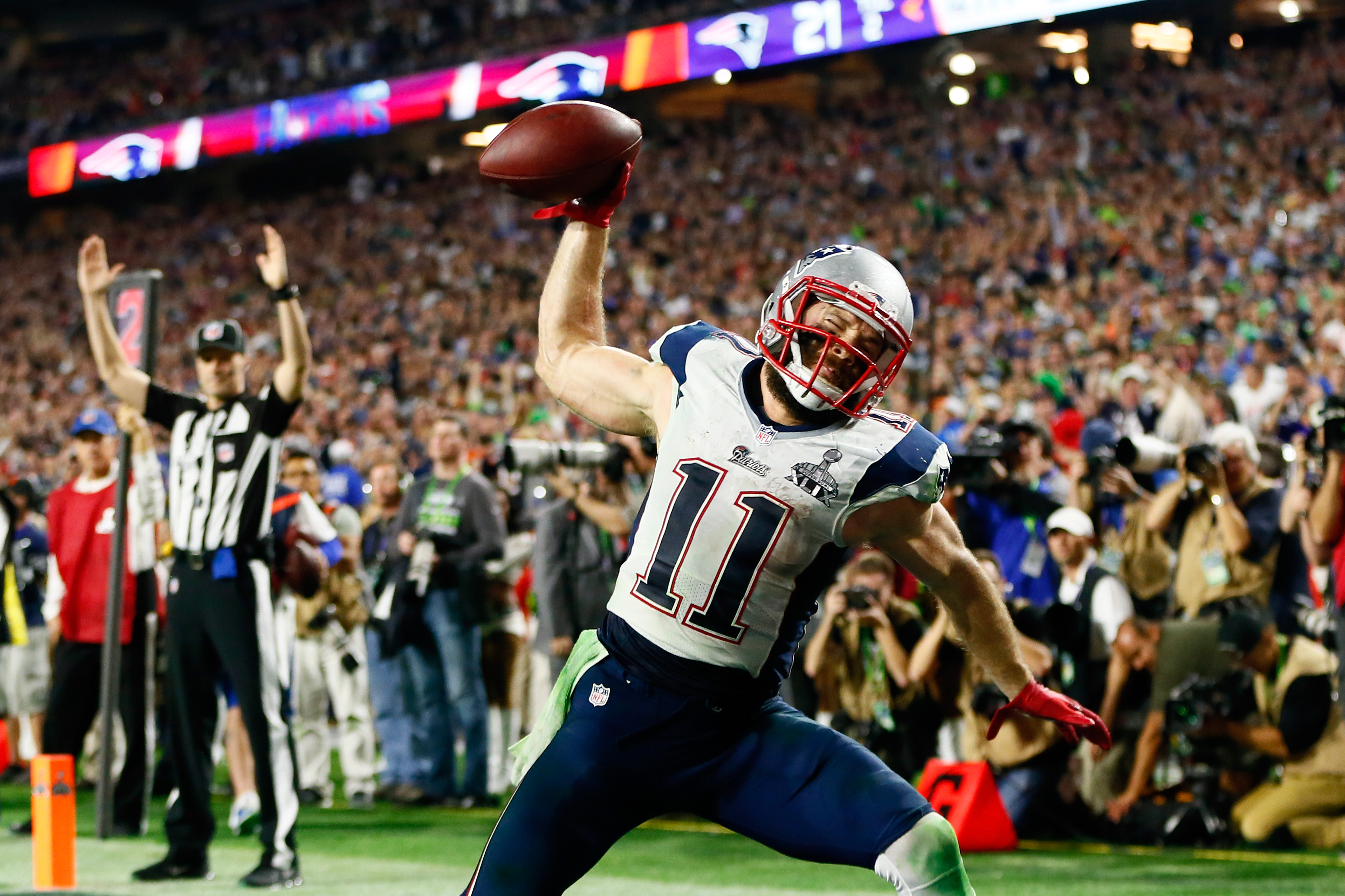 Julian Edelman #11 of the New England Patriots celebrates as he scores a 3 yard touchdown in the fourth quarter against Seattle Seahawks during Super Bowl XLIX at University of Phoenix Stadium on February 1, 2015 in Glendale, Arizona.