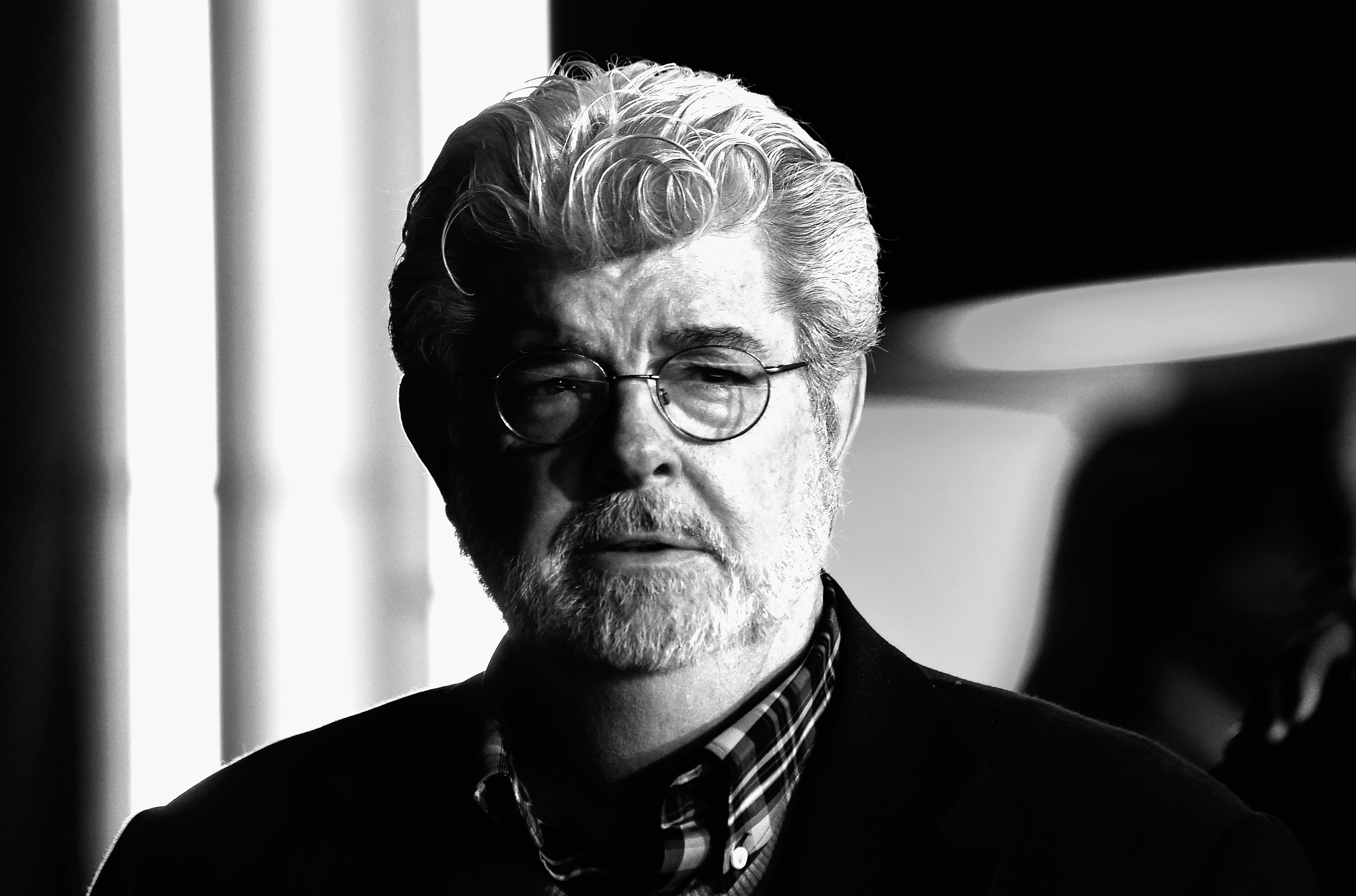 Director George Lucas arrives at The Premiere of Walt Disney Pictures and Lucasfilm's  Star Wars: The Force Awakens  on December 14, 2015 in Hollywood, California.
