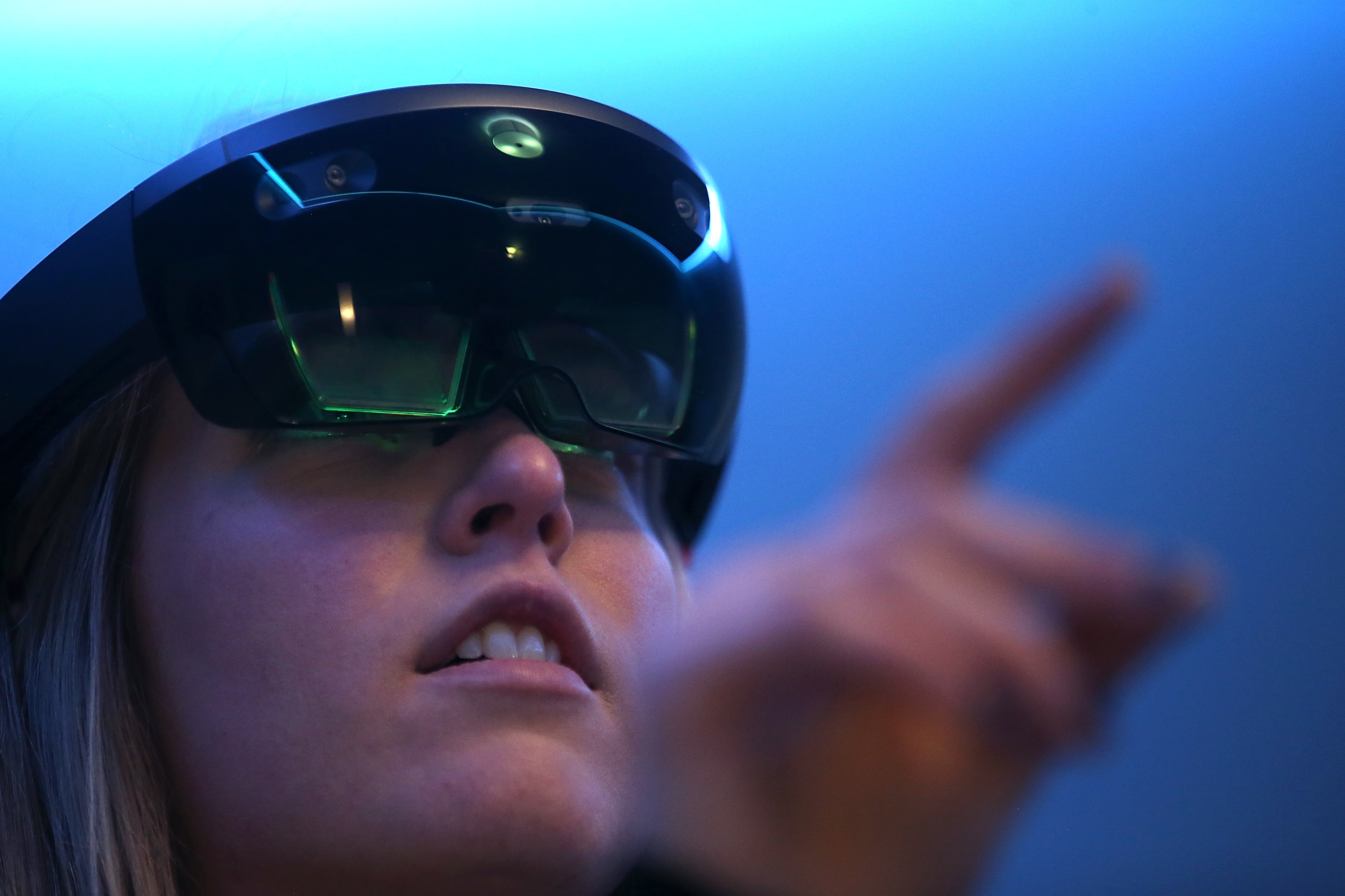 Microsoft employee Gillian Pennington demonstrates the Microsoft HoloLens augmented reality (AR) viewer during the 2016 Microsoft Build Developer Conference on March 30, 2016 in San Francisco, California.