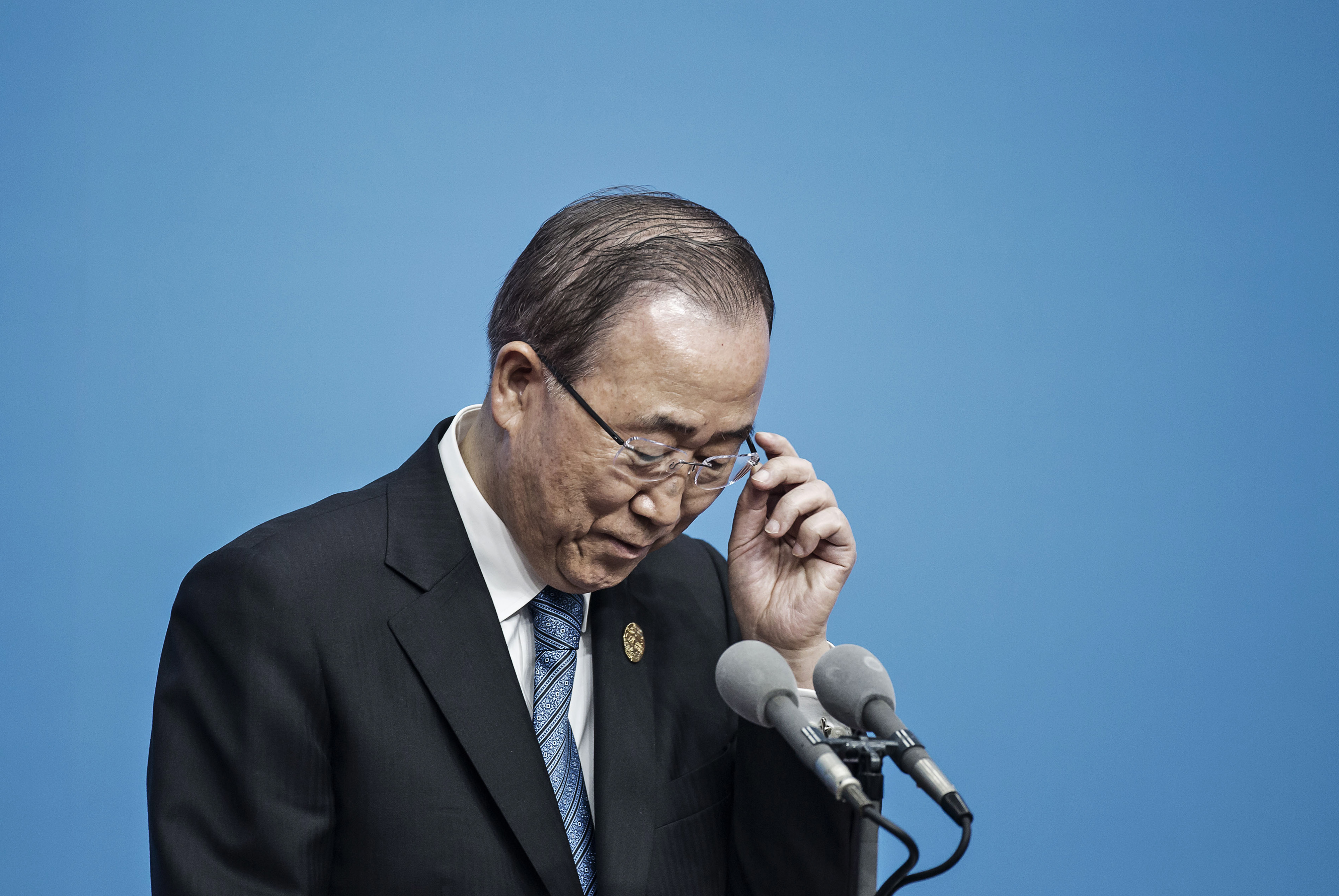 Ban Ki-Moon, then secretary general of the United Nations, adjusts his glasses during a news conference on the sidelines of the Group of 20 (G-20) summit in Hangzhou, China, on Sunday, Sept. 4, 2016.