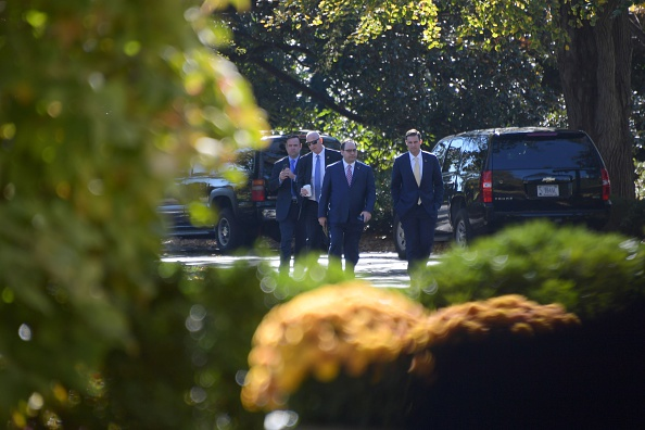 Trump aide Dan Scavino (left) and other members of President-elect Donald Trump's staff arrive at the White House as Trump attends a transition planning meeting with US President Barack Obama on November 10, 2016 in Washington, D.C.