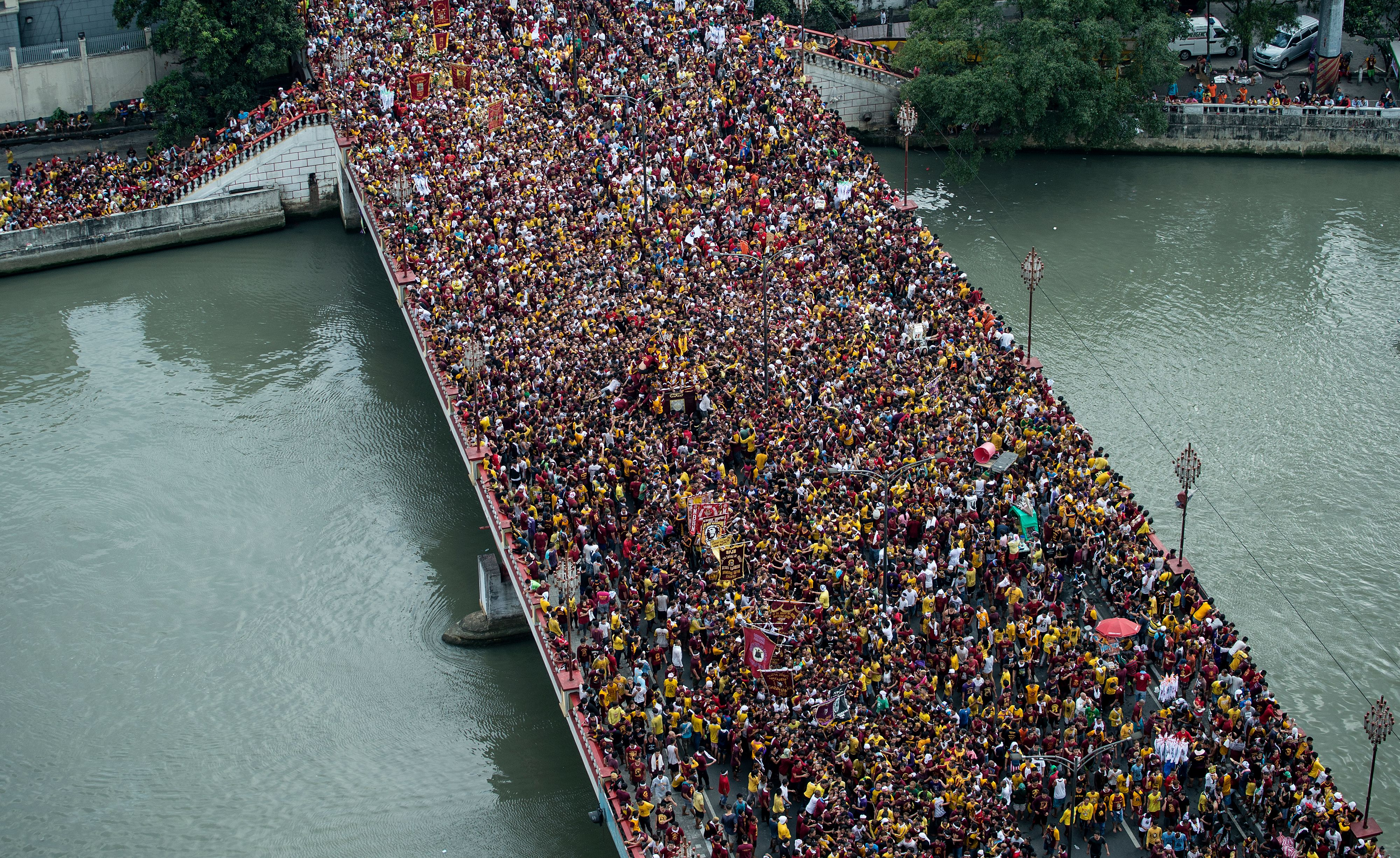 Devotees join the annual procession with the religious icon of the Black Nazarene in Manila on Jan. 9, 2017