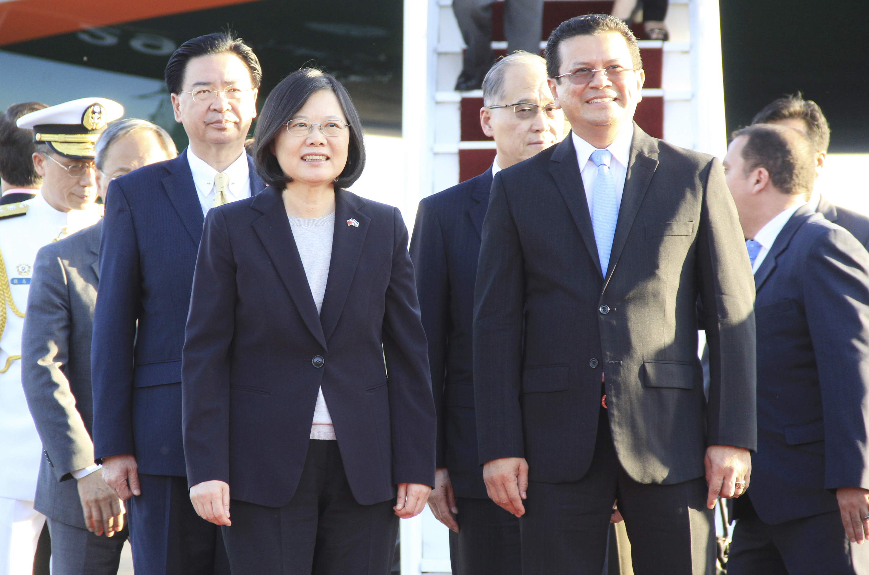 In this handout photo provided by the Salvadorian Chancery, Tsai Ing-wen, President of Taiwan, left, and the Chancellor of the Republic of El Salvador, Hugo Martínez, look on during her arrival at the Óscar Arnulfo Romero International Airport on Jan. 12, 2017, in La Paz, El Salvador