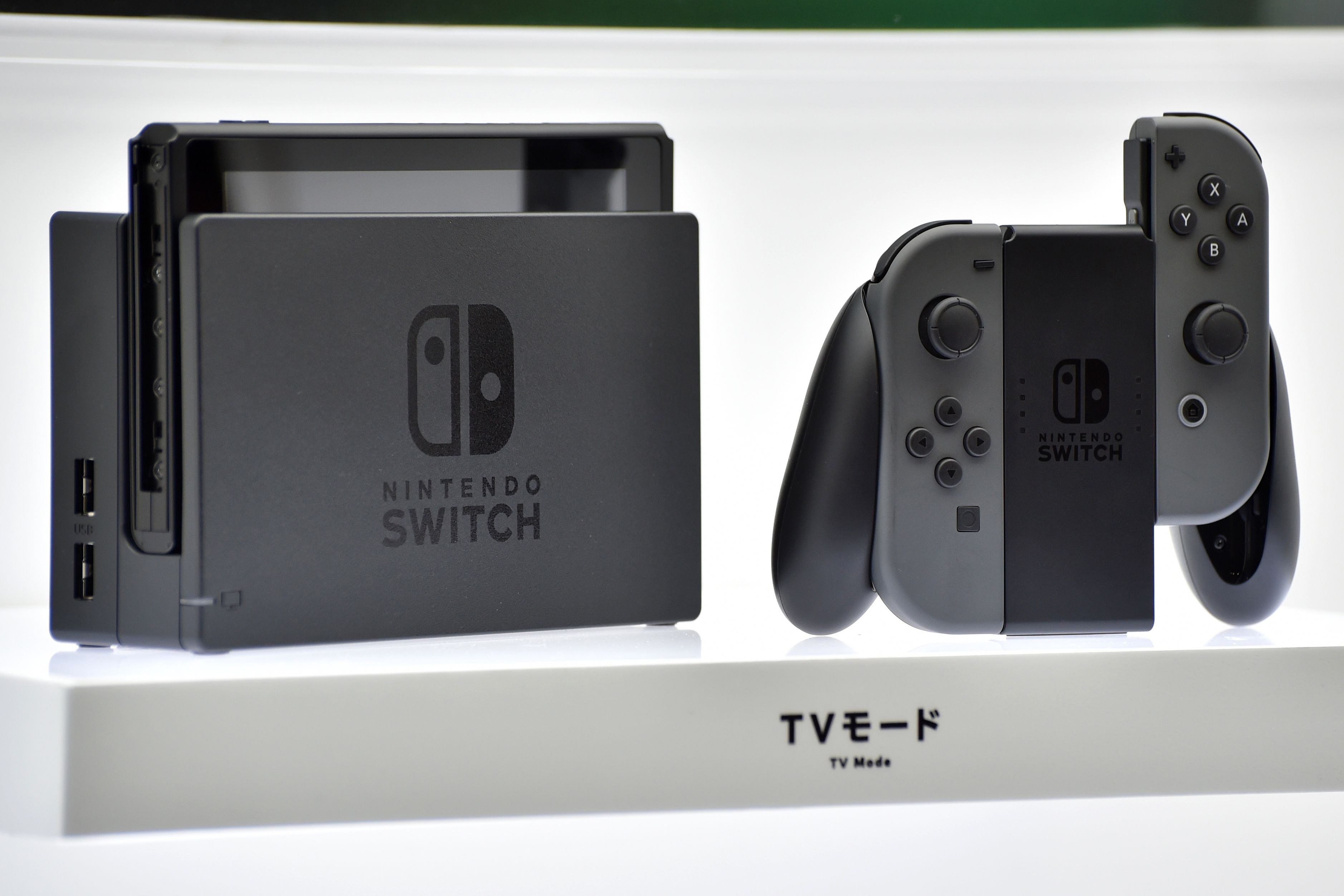 Nintendo's new video game console Switch is displayed at a presentation in Tokyo on January 13, 2017.                      Nintendo on January 13 unveiled its new Switch game console, which works both at home and on-the-go, as it looks to offset disappointing Wii U sales and go head to head with rival Sony's hugely popular PlayStation 4. / AFP / Kazuhiro NOGI        (Photo credit should read KAZUHIRO NOGI/AFP/Getty Images)