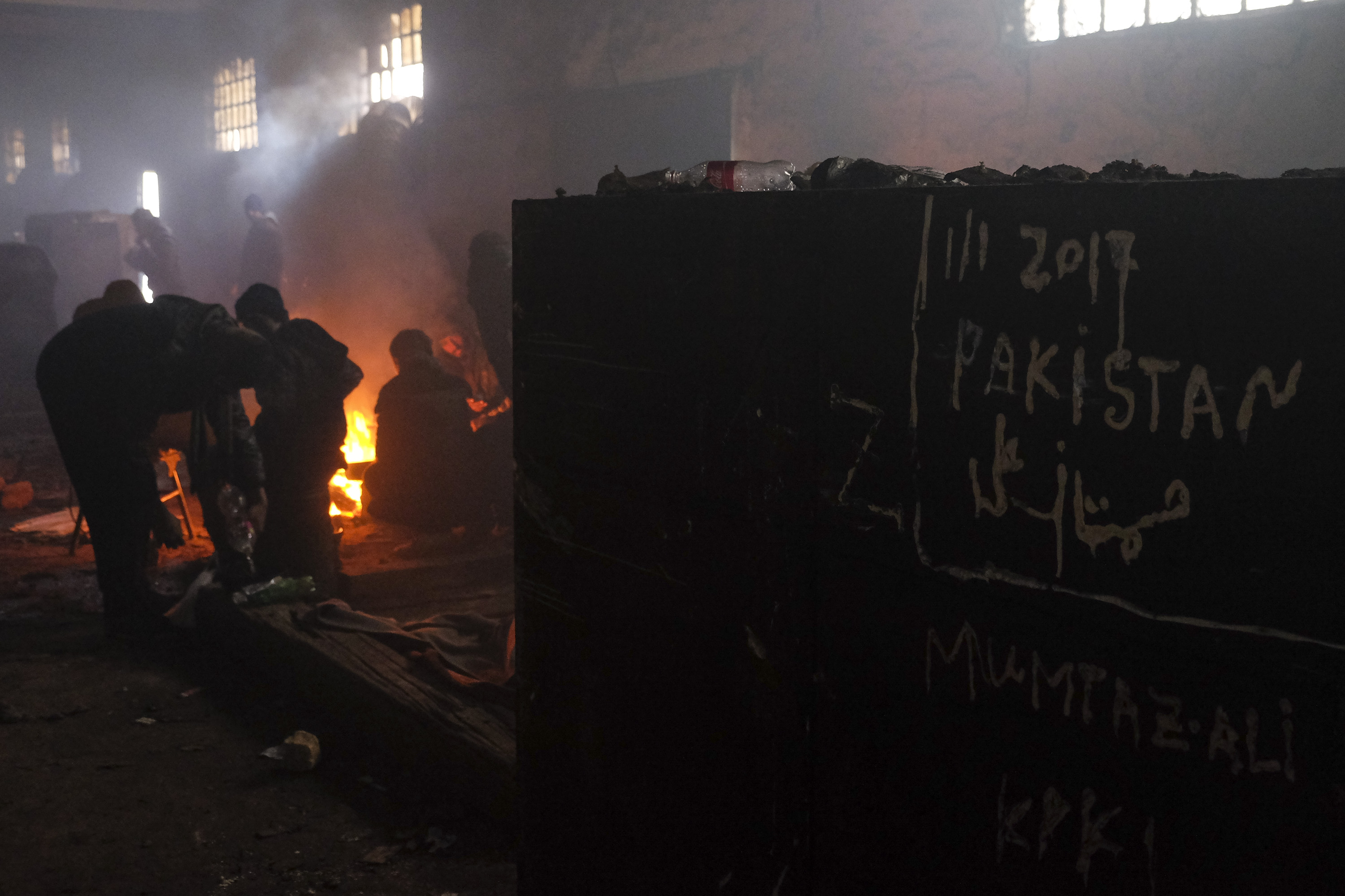 More than 1500 people are living in bleak conditions in one of the warehouses near the train station, Jan. 17, 2017 in Belgrade, Serbia.