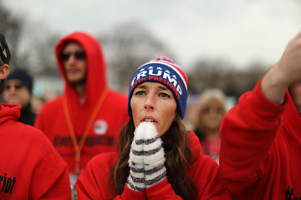 U.S. President Donald Trump supporters pray on the National Mall during the inauguration of US President Donald Trump on January 20, 2017 in Washington, D.C.