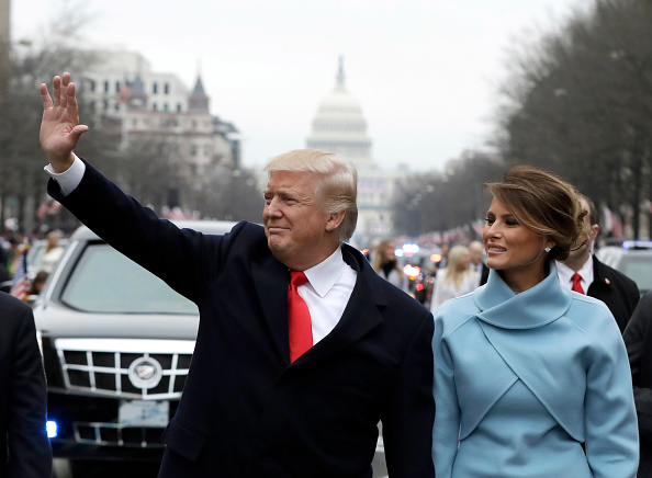 U.S. President Donald Trump waves to supporters as he walks the parade route with first lady Melania Trump after being sworn in at the 58th Presidential Inauguration January 20, 2017 in Washington, D.C.