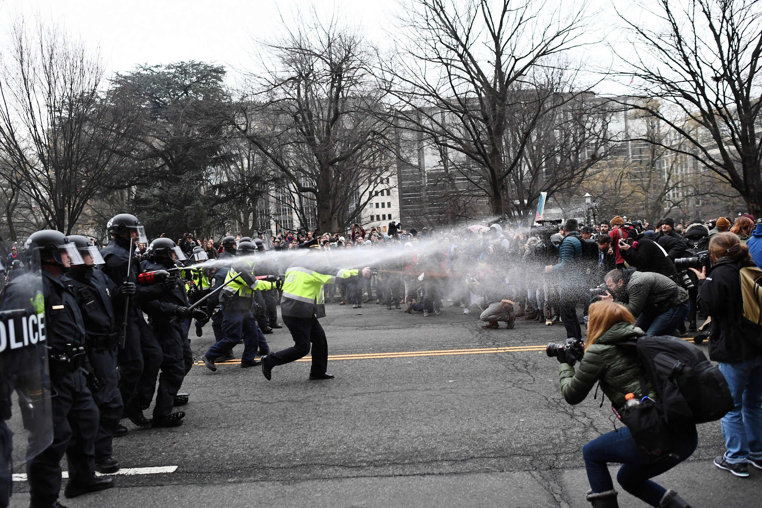 Police pepper spray at anti-Trump protesters in Washington, on Jan. 20, 2017.