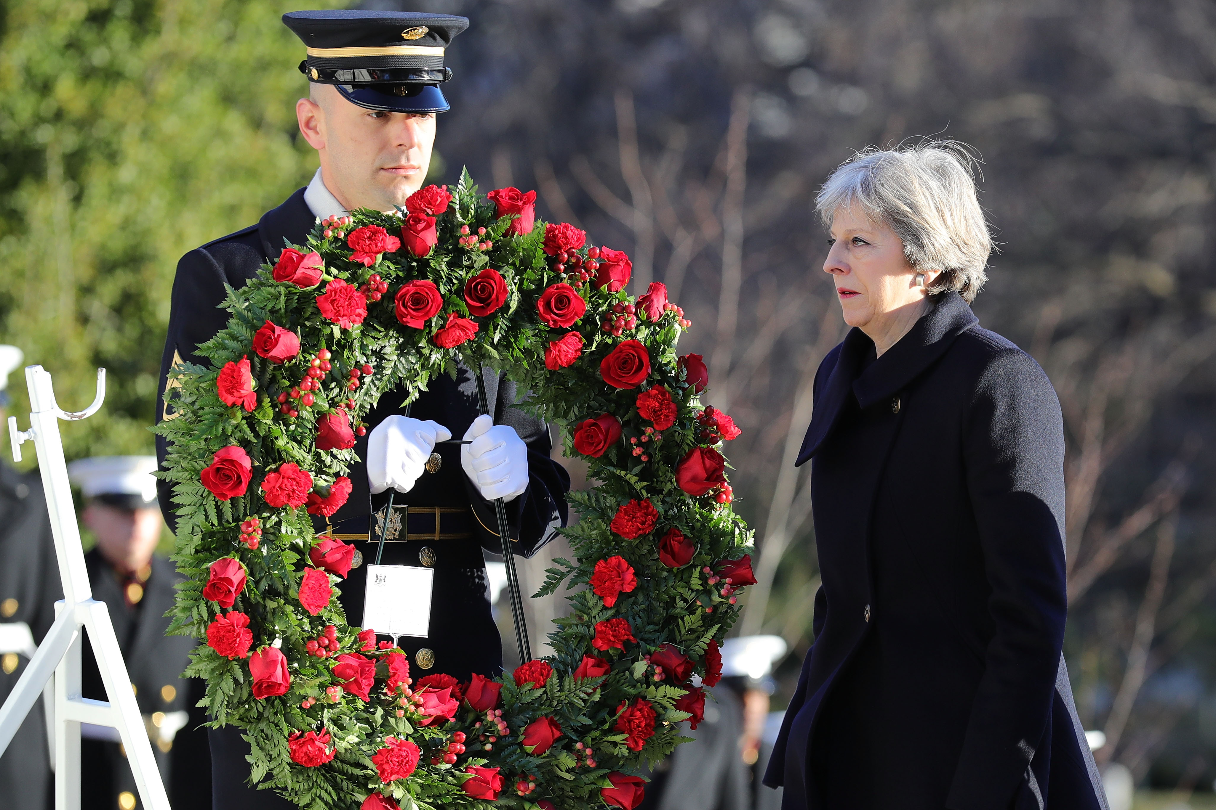 British Prime Minister Theresa May lays a wreath at the Tomb of the Unknown Solider in Arlington National Cemetery on January 27, 2017 in Arlington, Virginia.