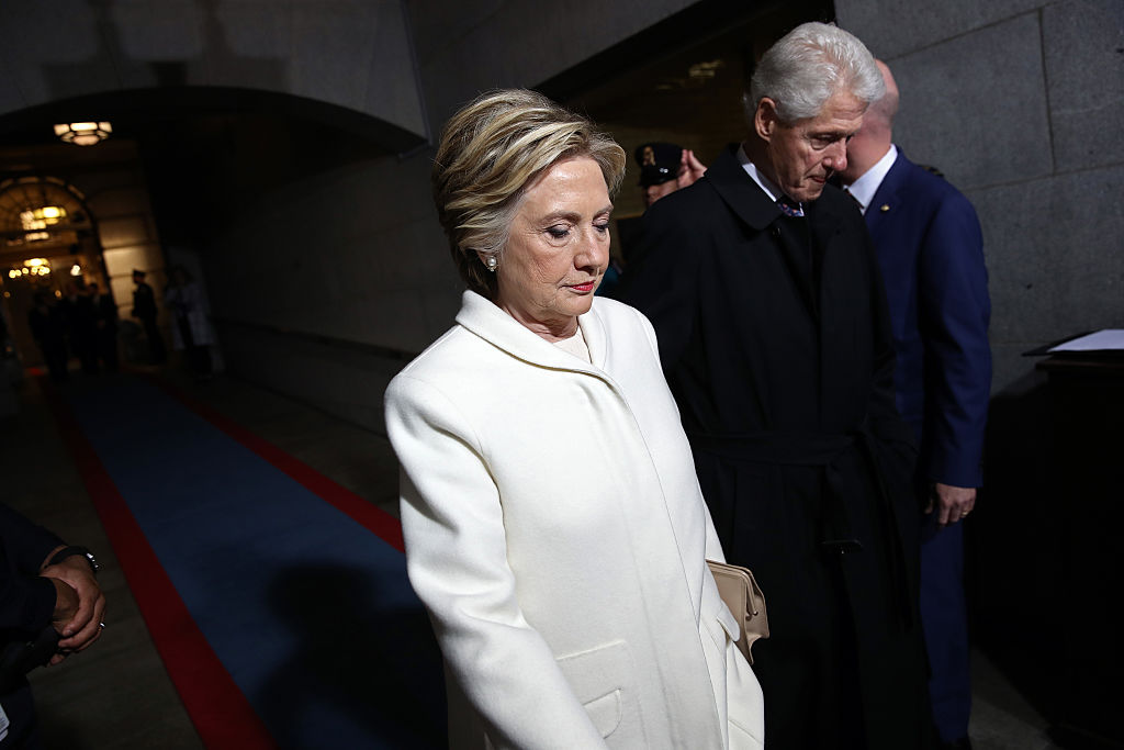 Former Democratic presidential nominee Hillary Clinton (L) and former President Bill Clinton arrive on the West Front of the U.S. Capitol on Jan. 20, 2017 in Washington, DC.