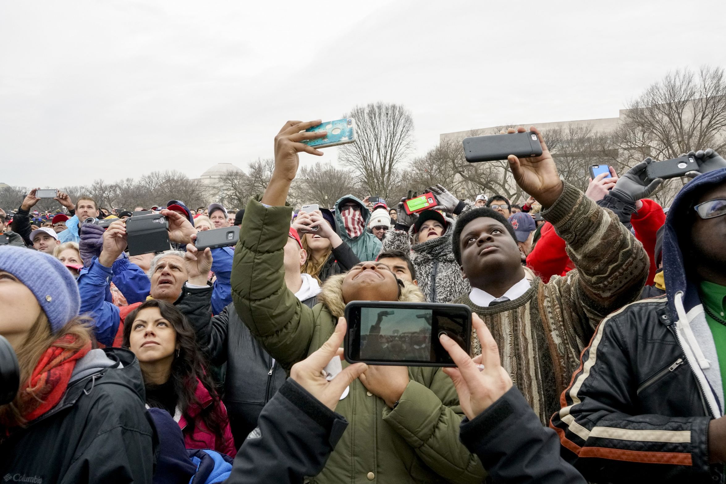 The crowd reacts to the inauguration address of Donald Trump, after he was sworn in as the 45th President of the United States on the National Mall in Washington D.C., on Jan 20, 2017.