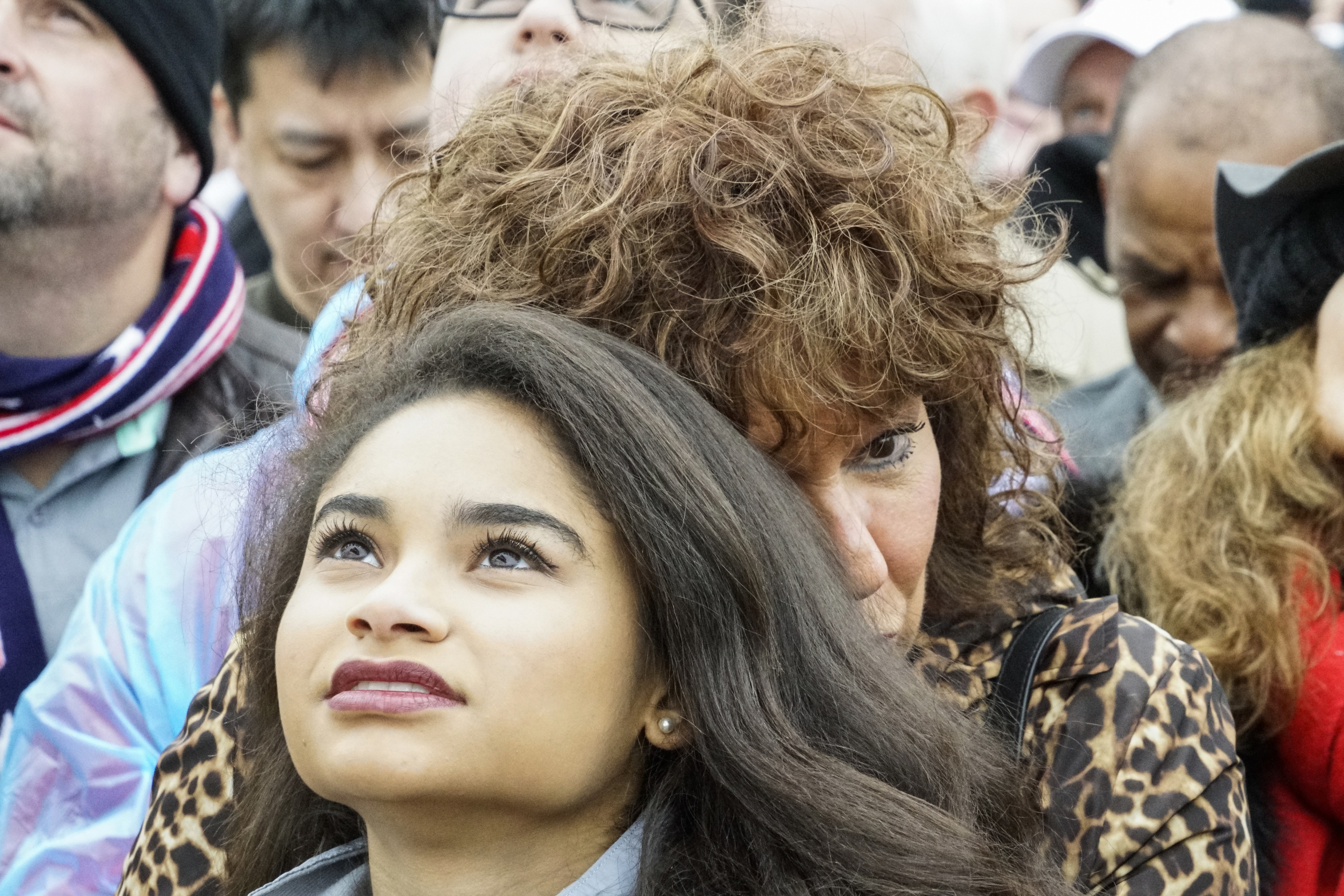 An attendee listens to the inauguration address of Donald Trump, after he was sworn in as the 45th President of the United States on the National Mall in Washington D.C., on Jan 20, 2017.