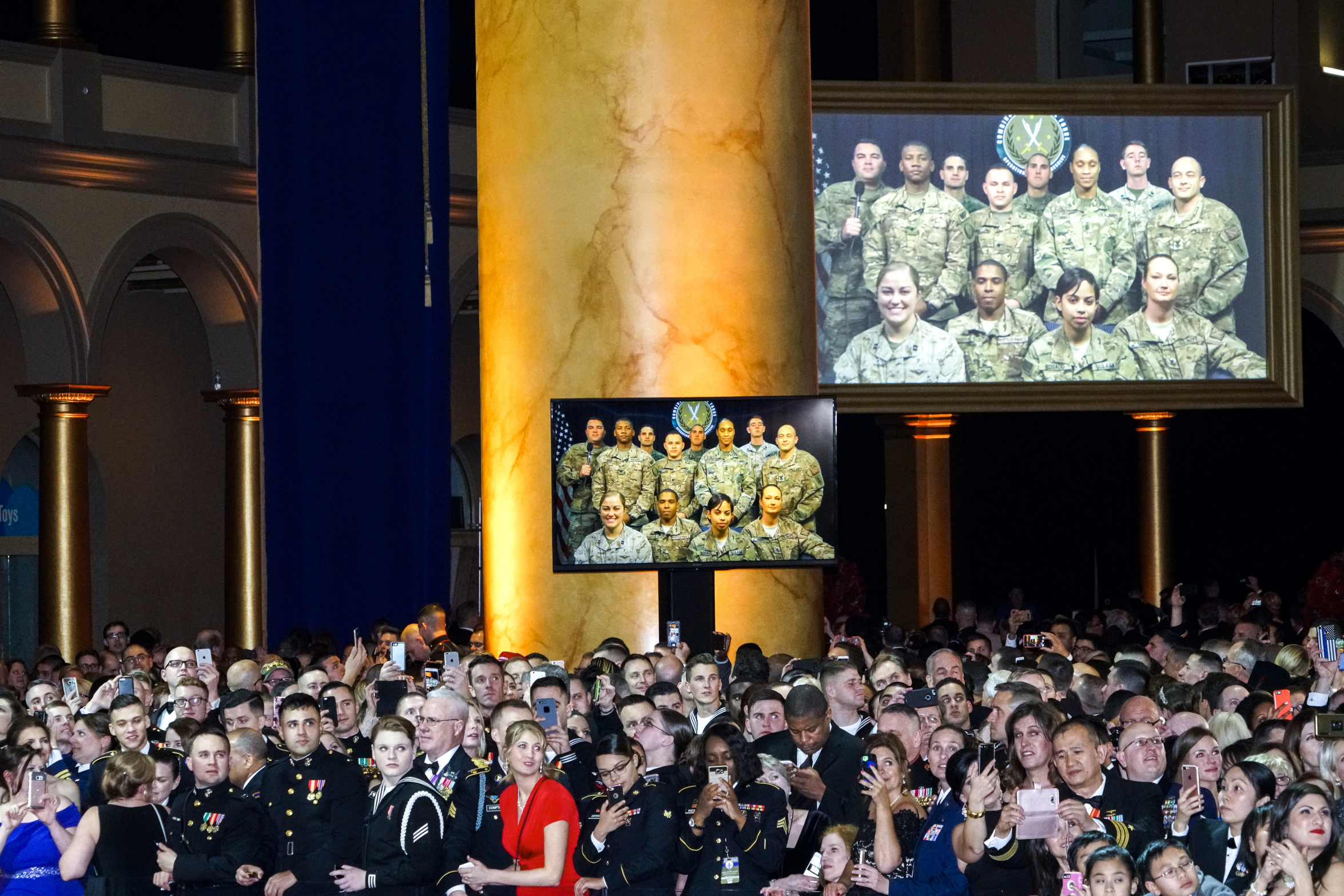 Members of the US Armed Forces wait for President Donald Trump and First Lady Melania Trump during the Salute to Our Armed Services Inaugural Ball at the National Building Museum in Washington, D.C., on Jan 20, 2017.