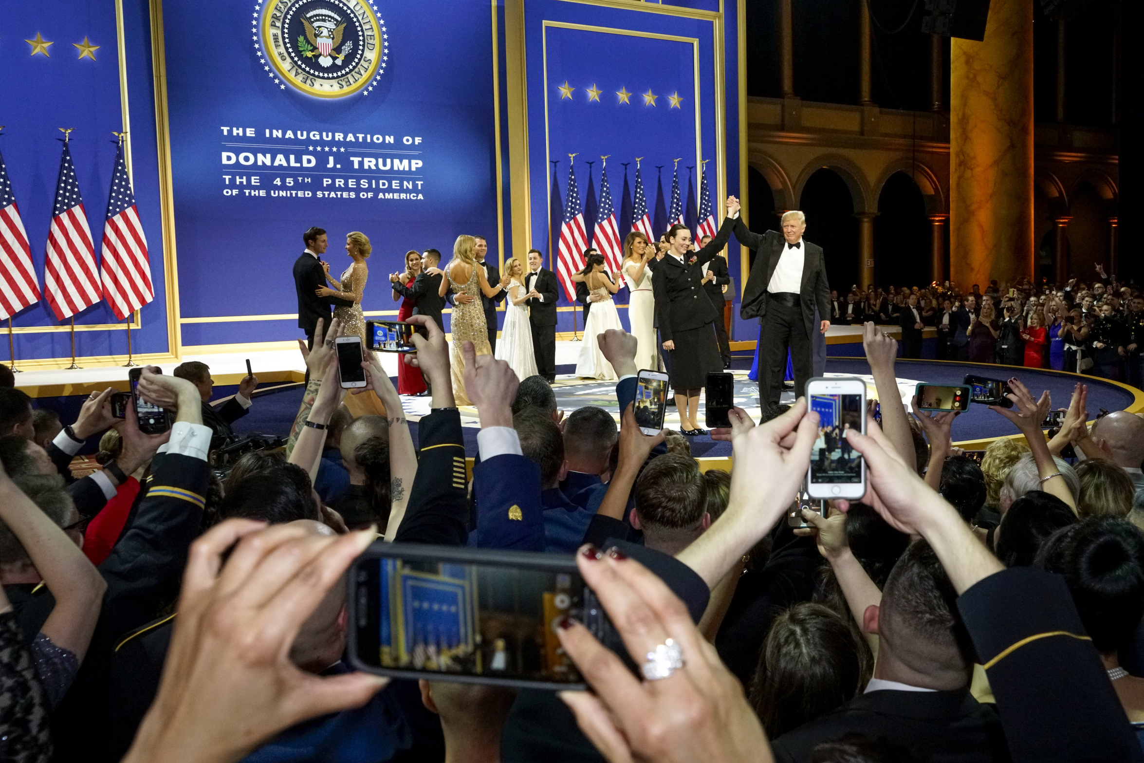 U.S. President Donald Trump applauds members of the armed services during the Armed Services Inaugural Ball in Washington, D.C., on Friday, Jan. 20, 2017.