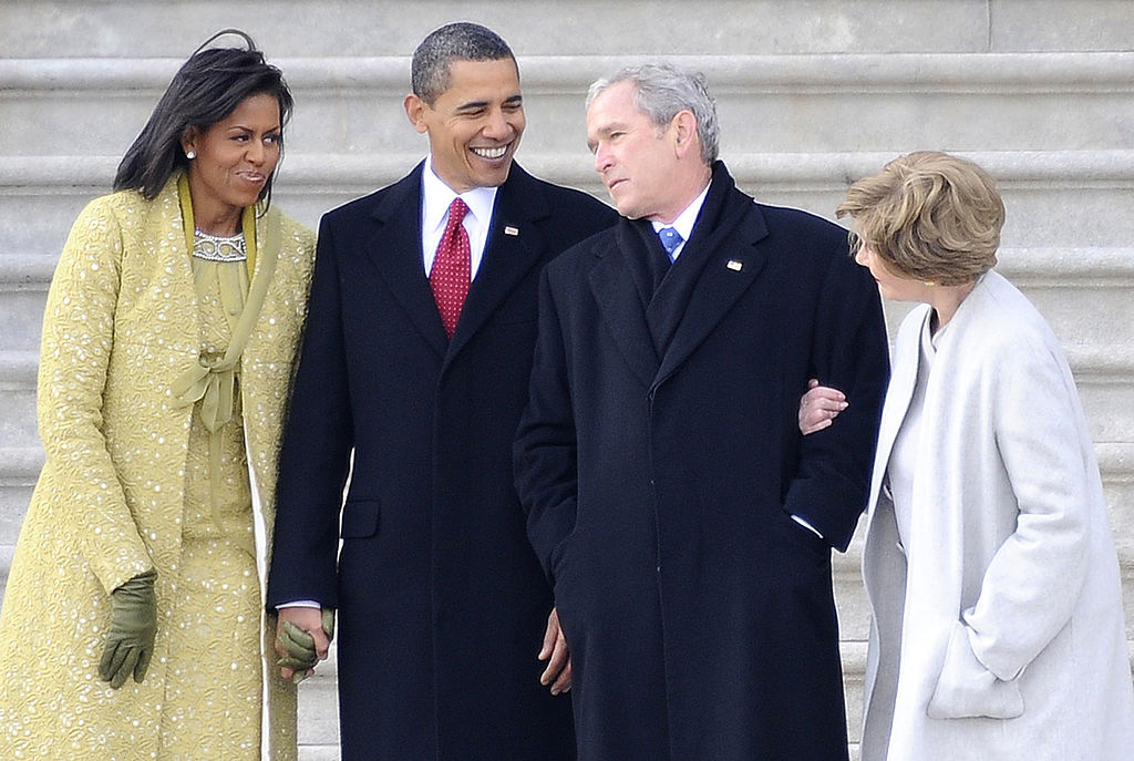Former President George W. Bush (2-R), his wife Laura (R) stand with President Barack Obama (2-L) and First Lady Michelle Obama (L) as Bush departs from the U.S. Capitol after the inauguration of Barack Obama as the 44th president of the U.S. on Jan. 20, 2009 in Washington, DC.