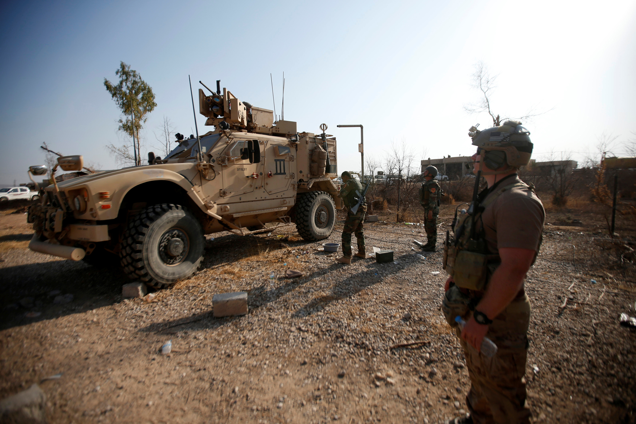 U.S. military vehicles are seen during an operation to attack Islamic State militants in the town of Bashiqa, east of Mosul, Iraq, on Nov. 7, 2016.
