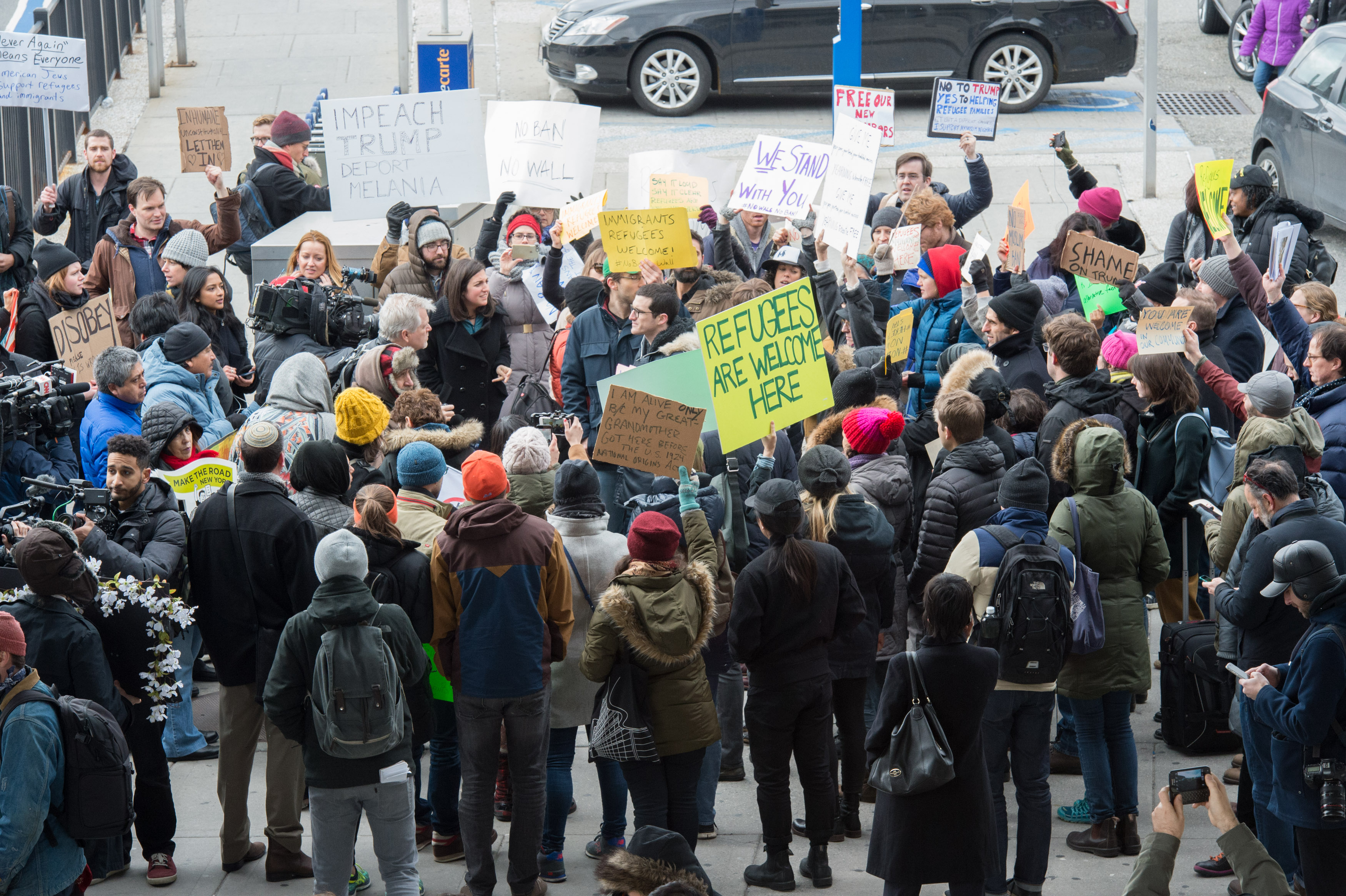 Protesters gather at JFK International Airport's Terminal 4 to demonstrate against Trump's executive order, on Jan. 28, 2016 in New York.