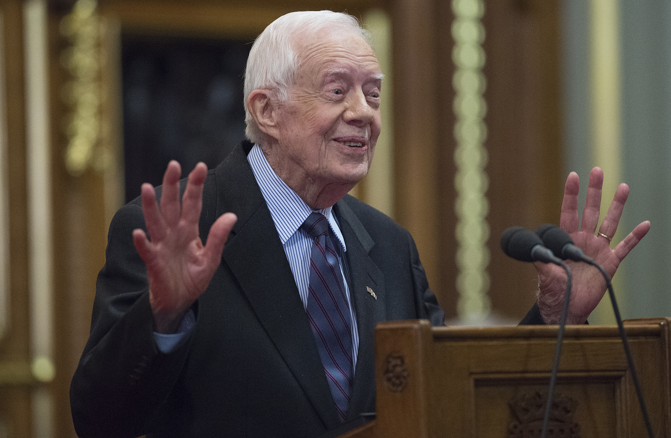 Former U.S. President Jimmy Carter delivers a lecture on the eradication of the Guinea worm at the House of Lords on Feb. 3, 2016 in London.