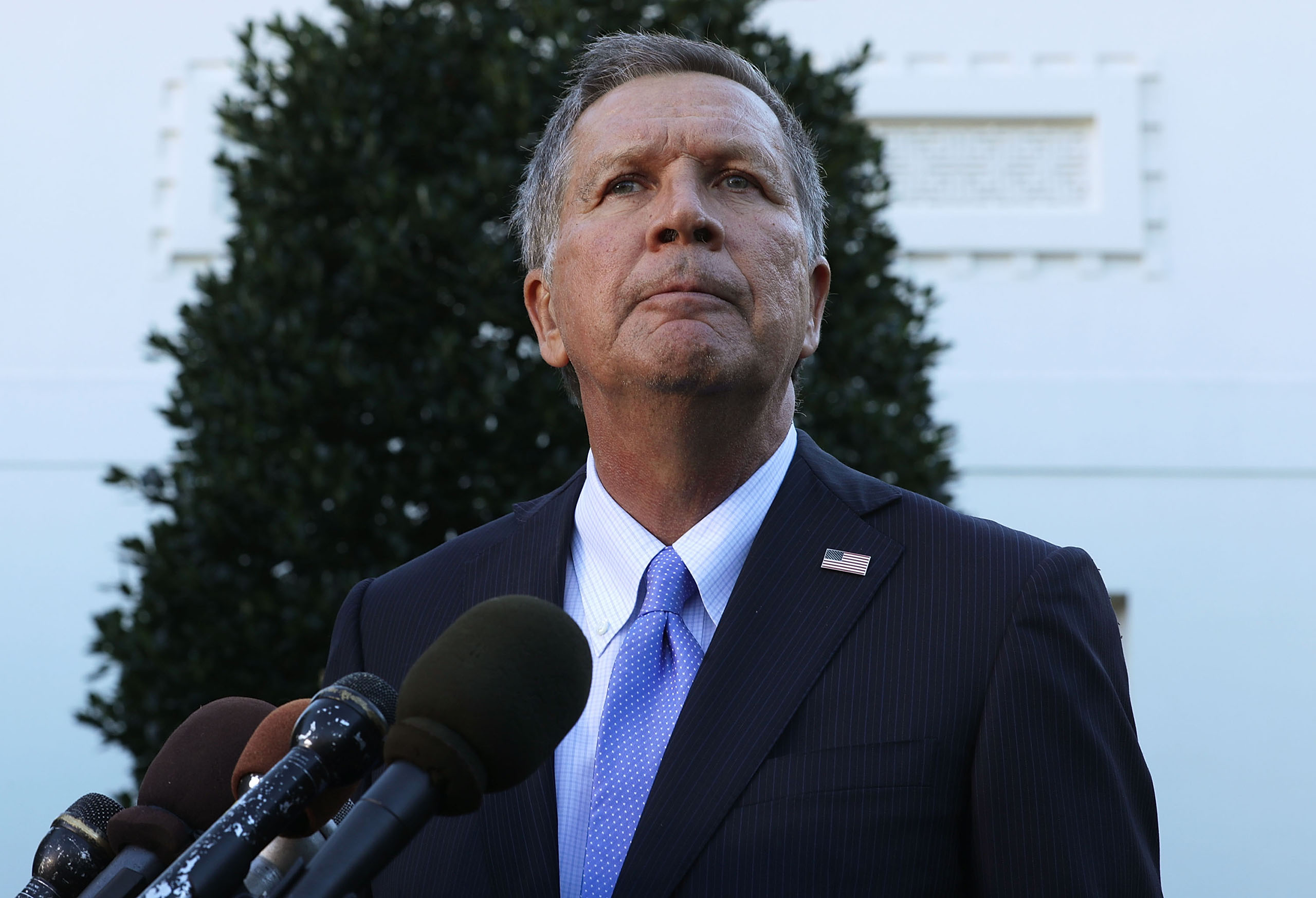 Ohio Governor John Kasich speaks to members of the media outside the West Wing on Nov. 10, 2016 at the White House in Washington, DC.