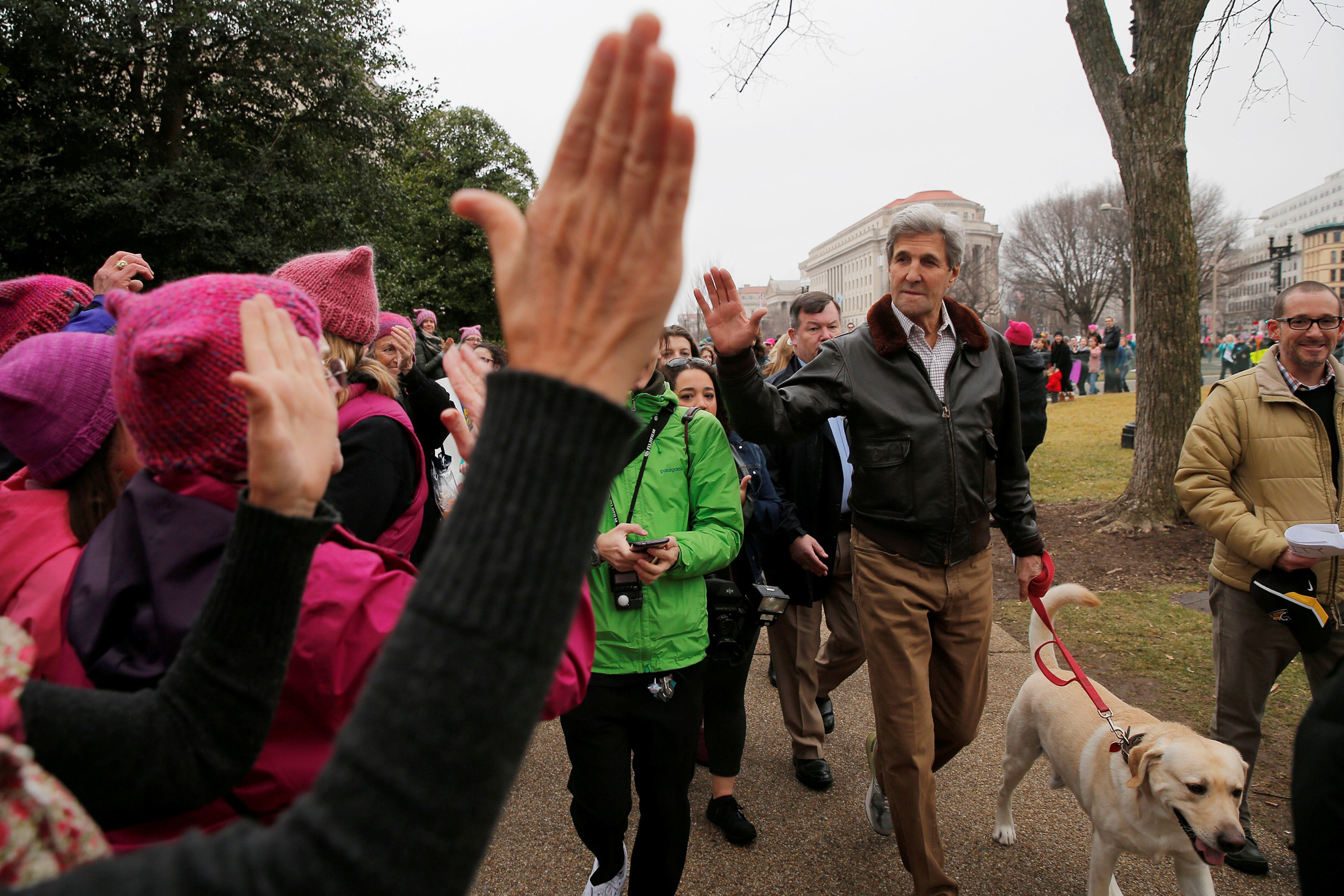 Former U.S. Secretary of State John Kerry walks his dog to join the Women's March on Washington, following the inauguration of U.S. President Donald Trump, on Jan. 21, 2017.
