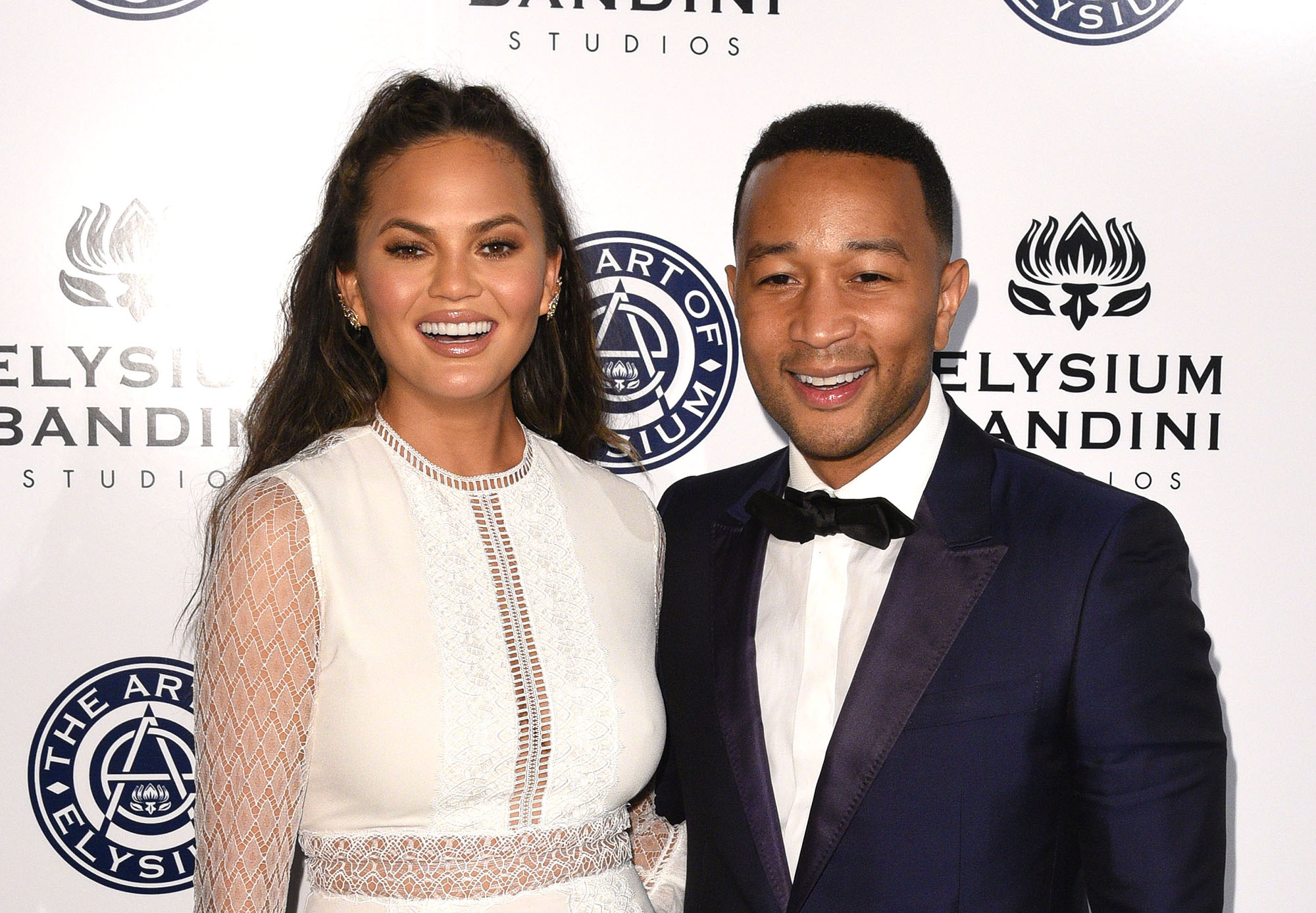 Chrissy Teigen and John Legend attend The Art of Elysium presents Stevie Wonder's HEAVEN - Celebrating the 10th Anniversary at Red Studios on January 7, 2017 in Los Angeles, California.  (Photo by C Flanigan/Getty Images)
