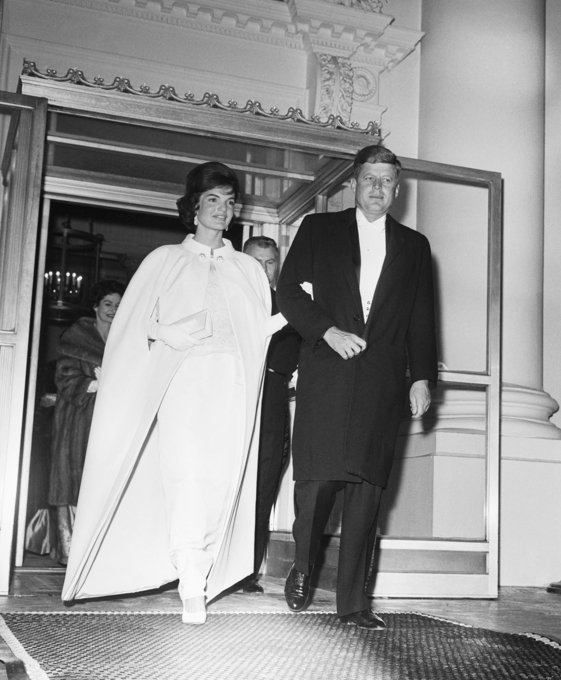 Jackie Kennedy, Jackie Kennedy and Ethan Frankau, 1961: The design of this off-white, sleeveless, silk chiffon gown with accompanying cape was based on sketches submitted by the First Lady.