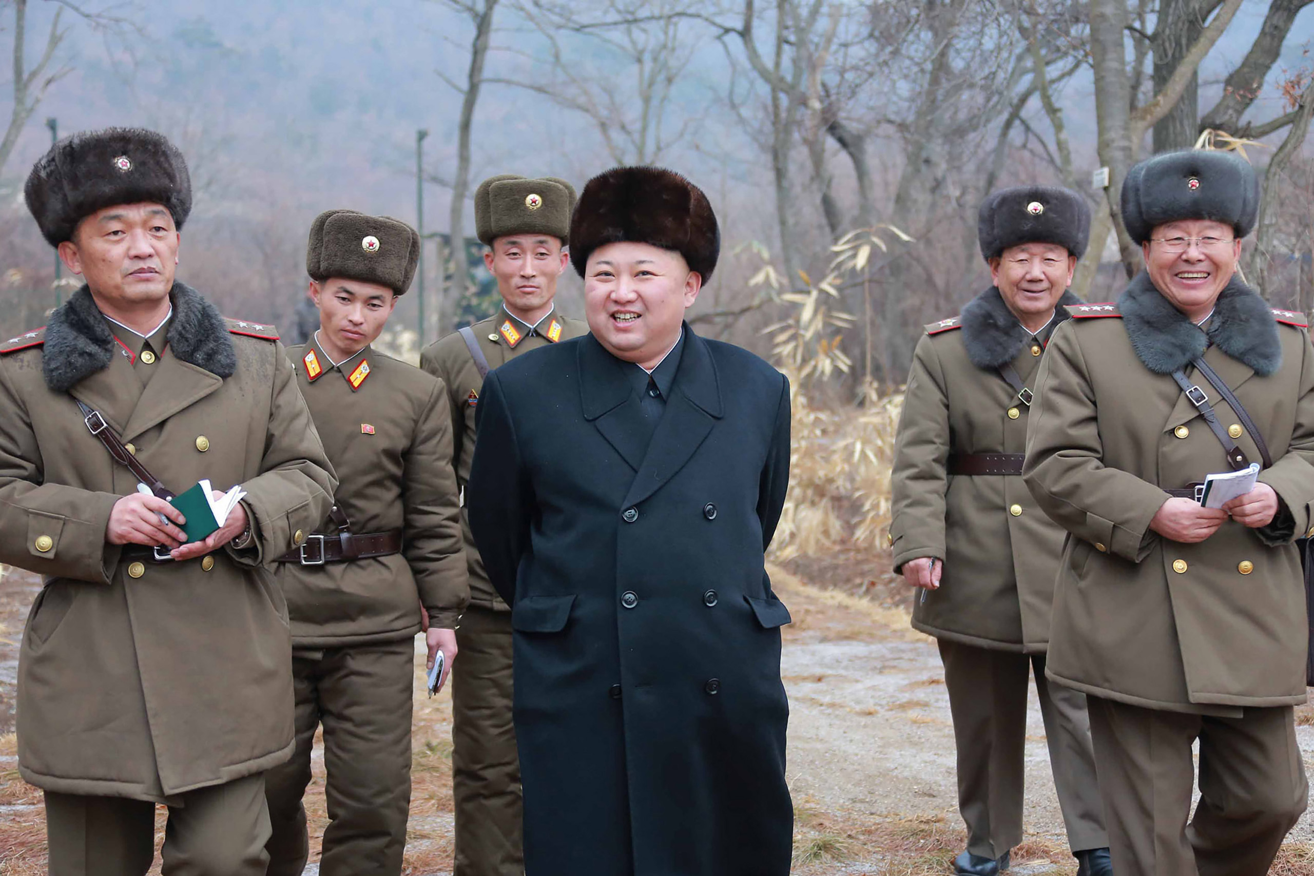 This undated picture released from North Korea's official Korean Central News Agency (KCNA) on Jan. 19, 2017 shows North Korean leader Kim Jong-Un (C) inspecting a sub-unit under KPA Unit 233 at an undisclosed location.