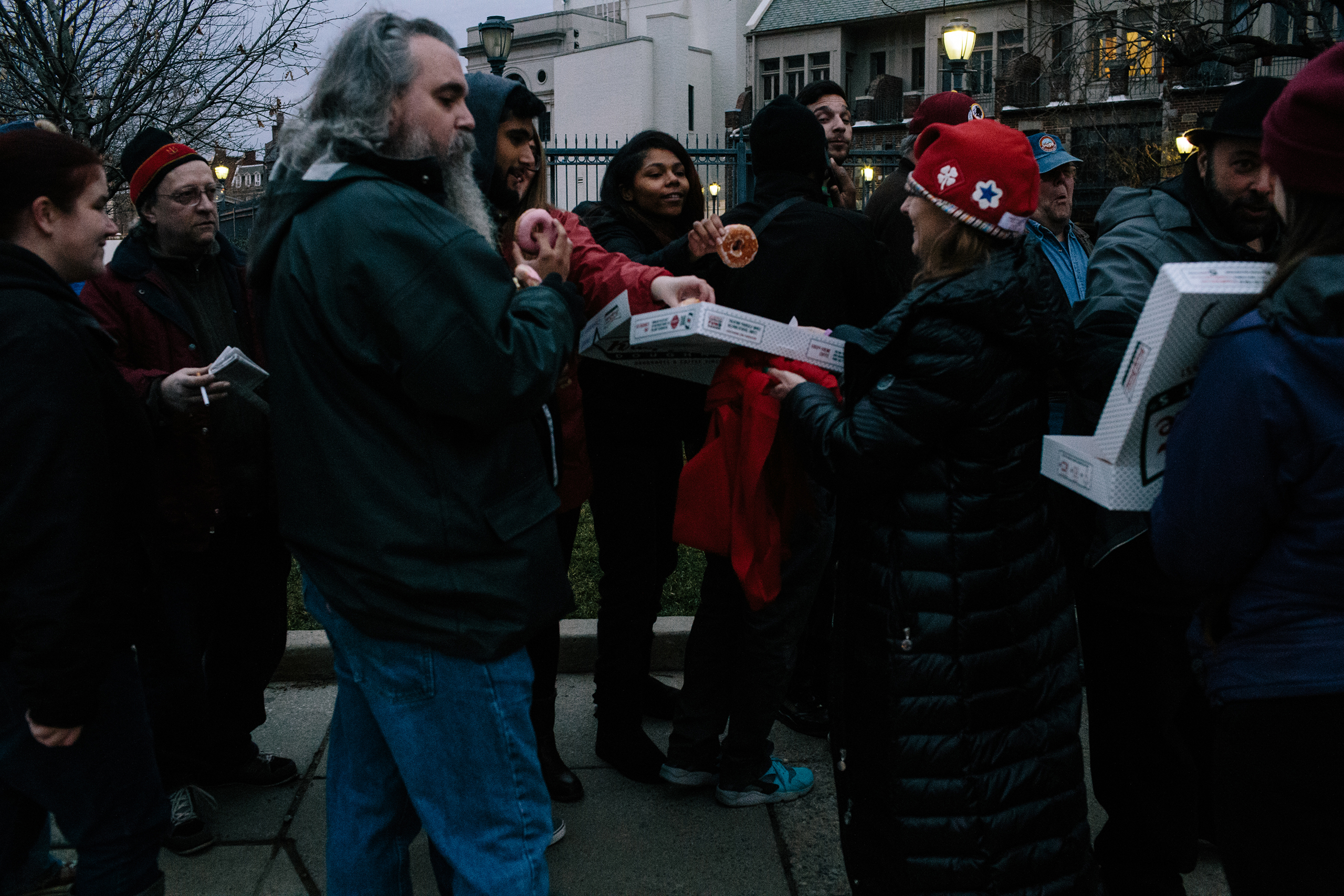 DCMJ, a D.C.-based marijuana advocacy group, hands out 420 donuts to people standing in line for a free joint Friday during the #Trump420 event on Jan. 20, 2017 in Washington.