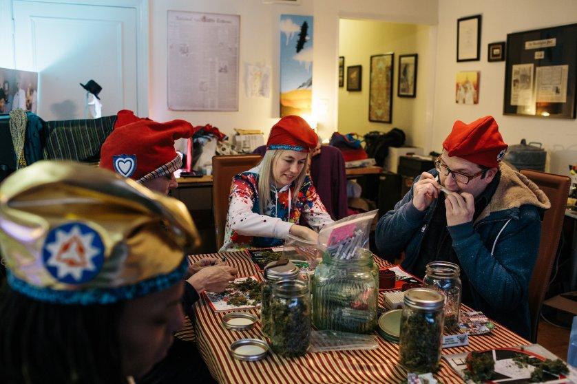 Adam Eidinger, of the cannabis community DCMJ, rolls a joint in a Washington, D.C., home on Jan. 16. The group will distribute thousands of joints before President-Elect Donald Trump's inauguration.