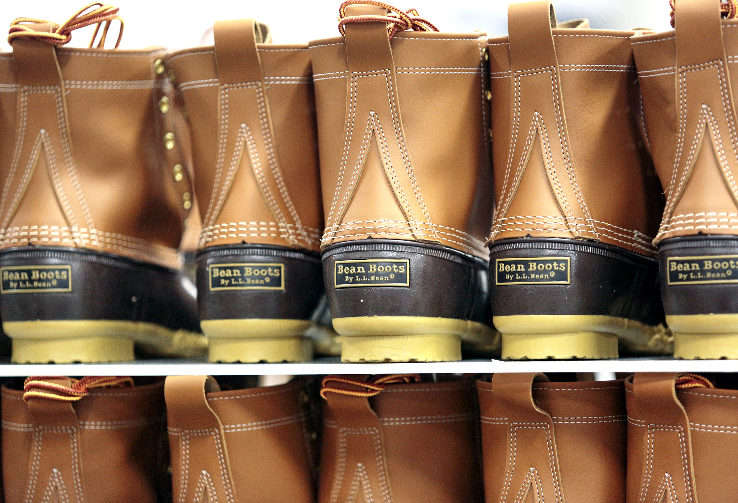 Bean Boots sit on a rack awaiting packaging at the L.L. Bean boot factory in Brunswick.