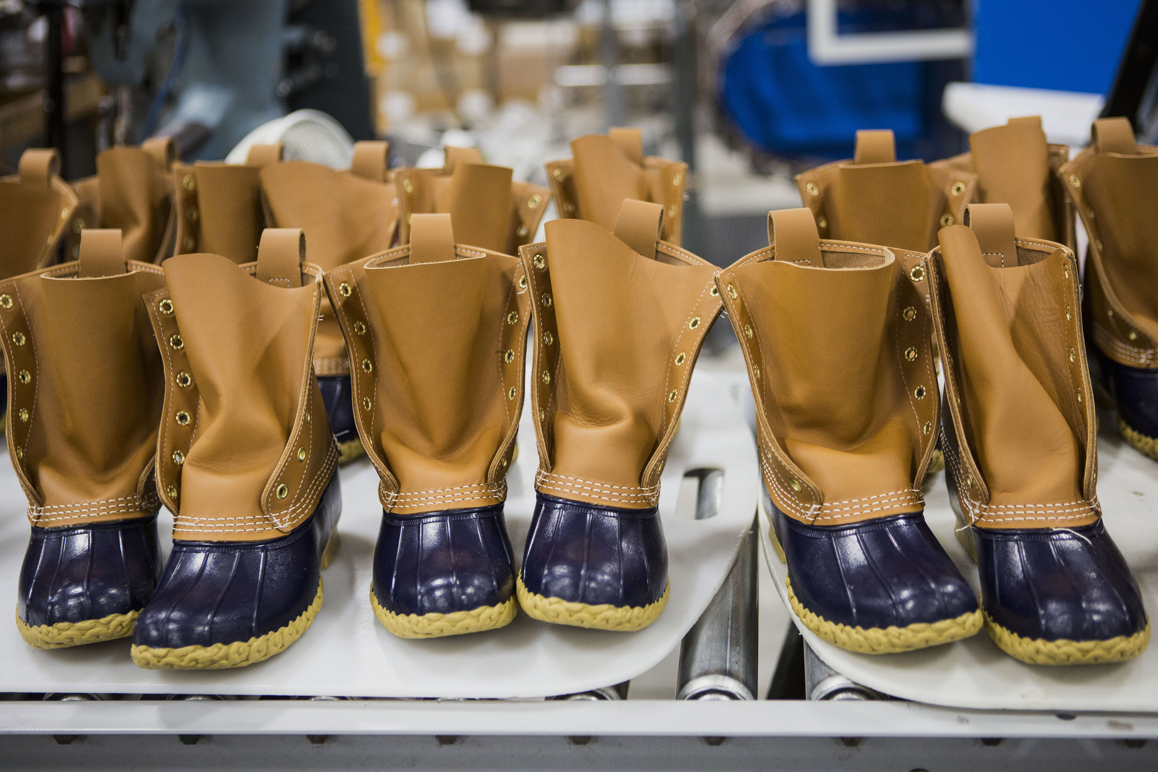Finished boots sit on a conveyor belt before being packaged at the L.L. Bean Inc. manufacturing facility in Brunswick, Maine on Sept. 9, 2015.
