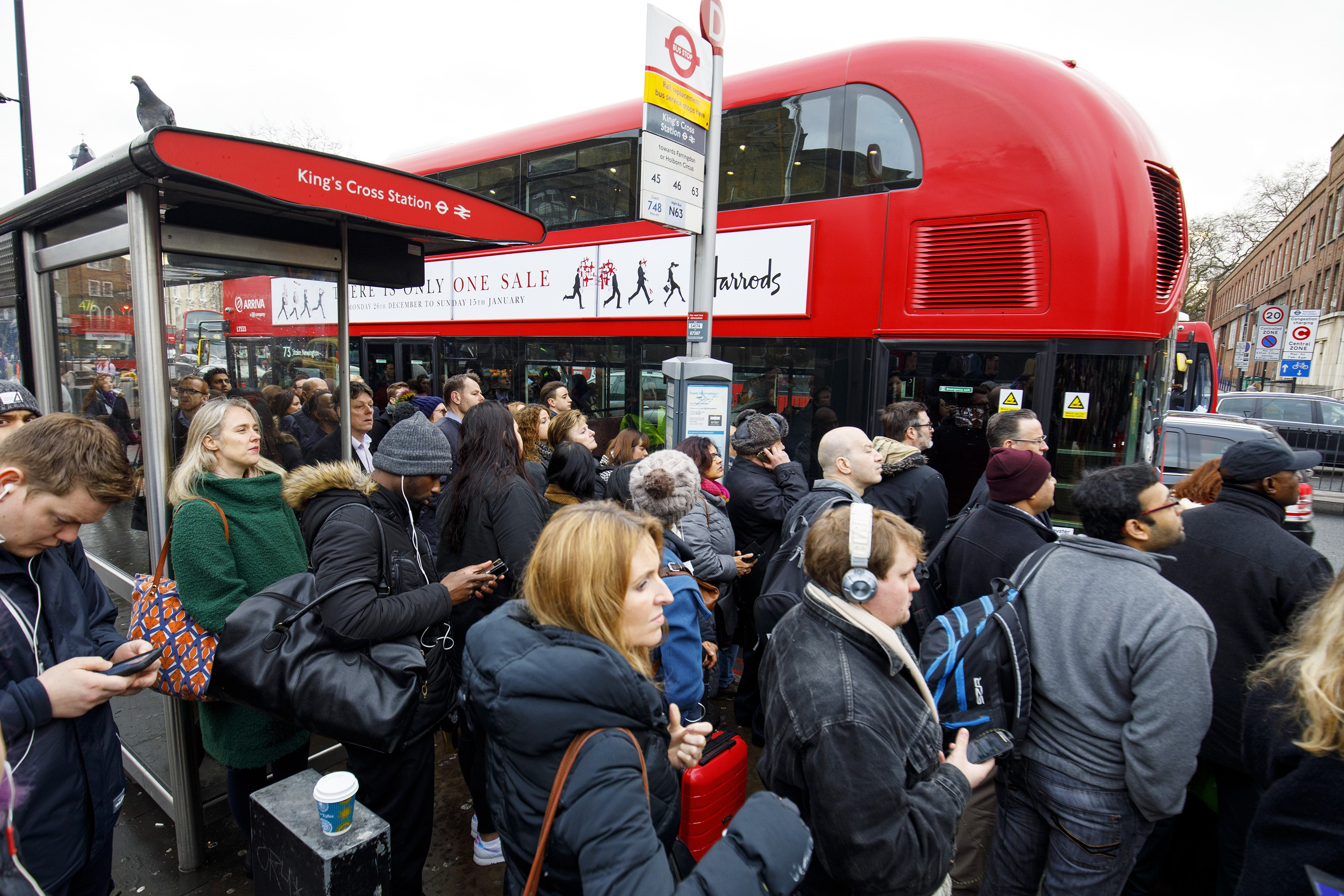 Commuters queue for buses outside King's Cross station as London Underground services are severely disrupted due to members of RMT and TSSA unions start a 24-hour strike action in a dispute over jobs cuts and closed ticket offices on January 9, 2017.
