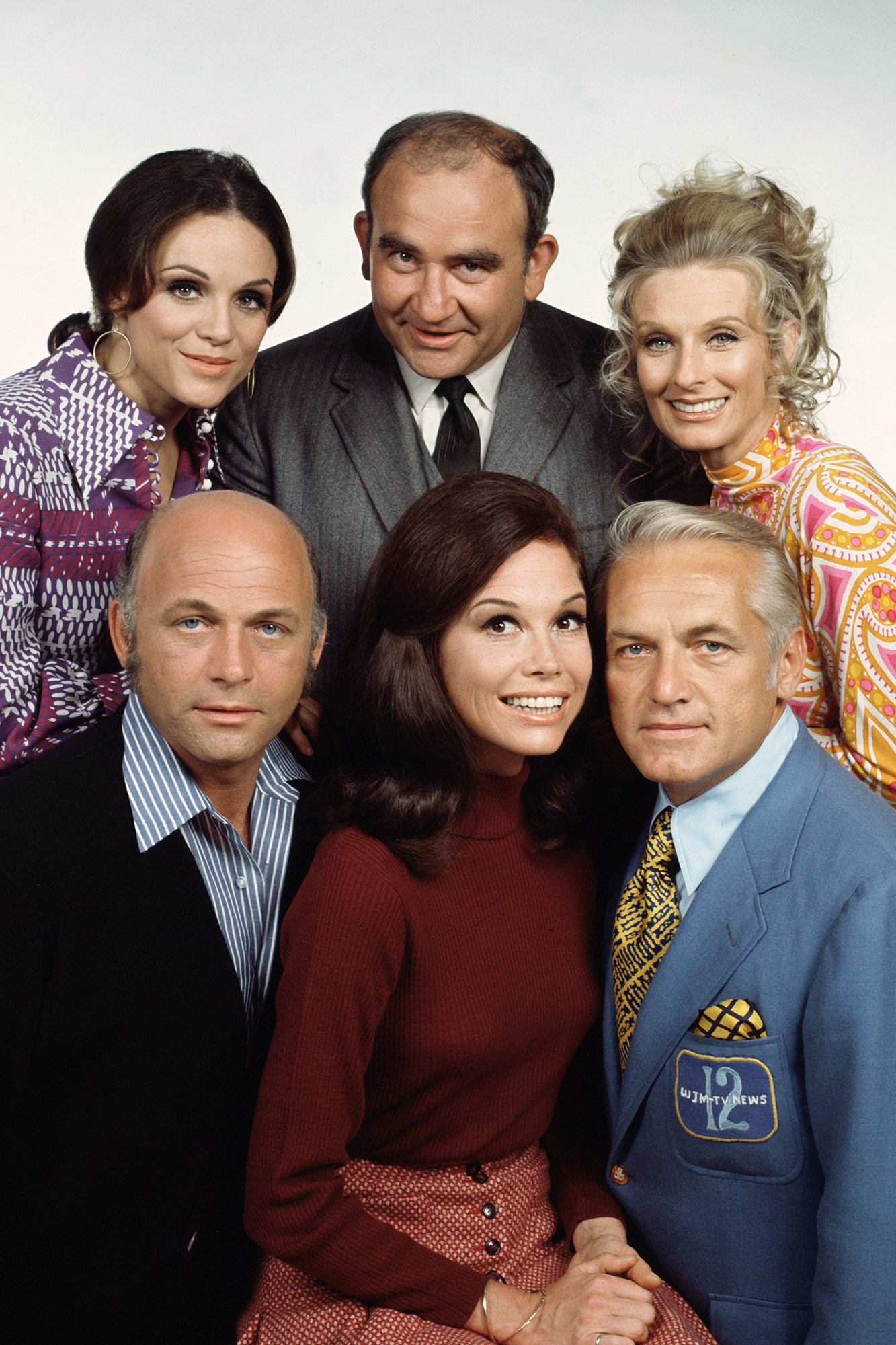 Clockwise from top left: Valerie Harper, Ed Asner, Cloris Leachman, Ted Knight, Mary Tyler Moore and Gavin MacLeod in a promo image from The Mary Tyler Moore Show in 1972.