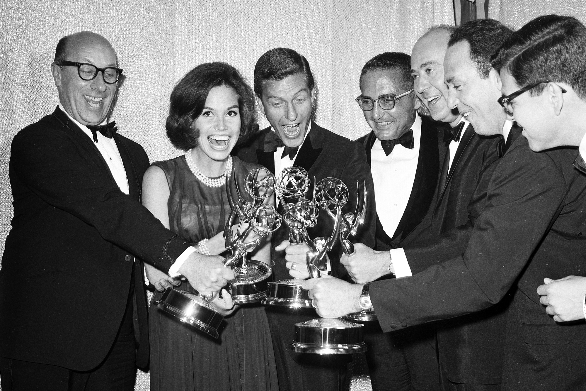 Mary Tyler Moore poses with co-stars of The Dick Van Dyke Show after receiving Emmy Awards c. 1962 in Los Angeles.