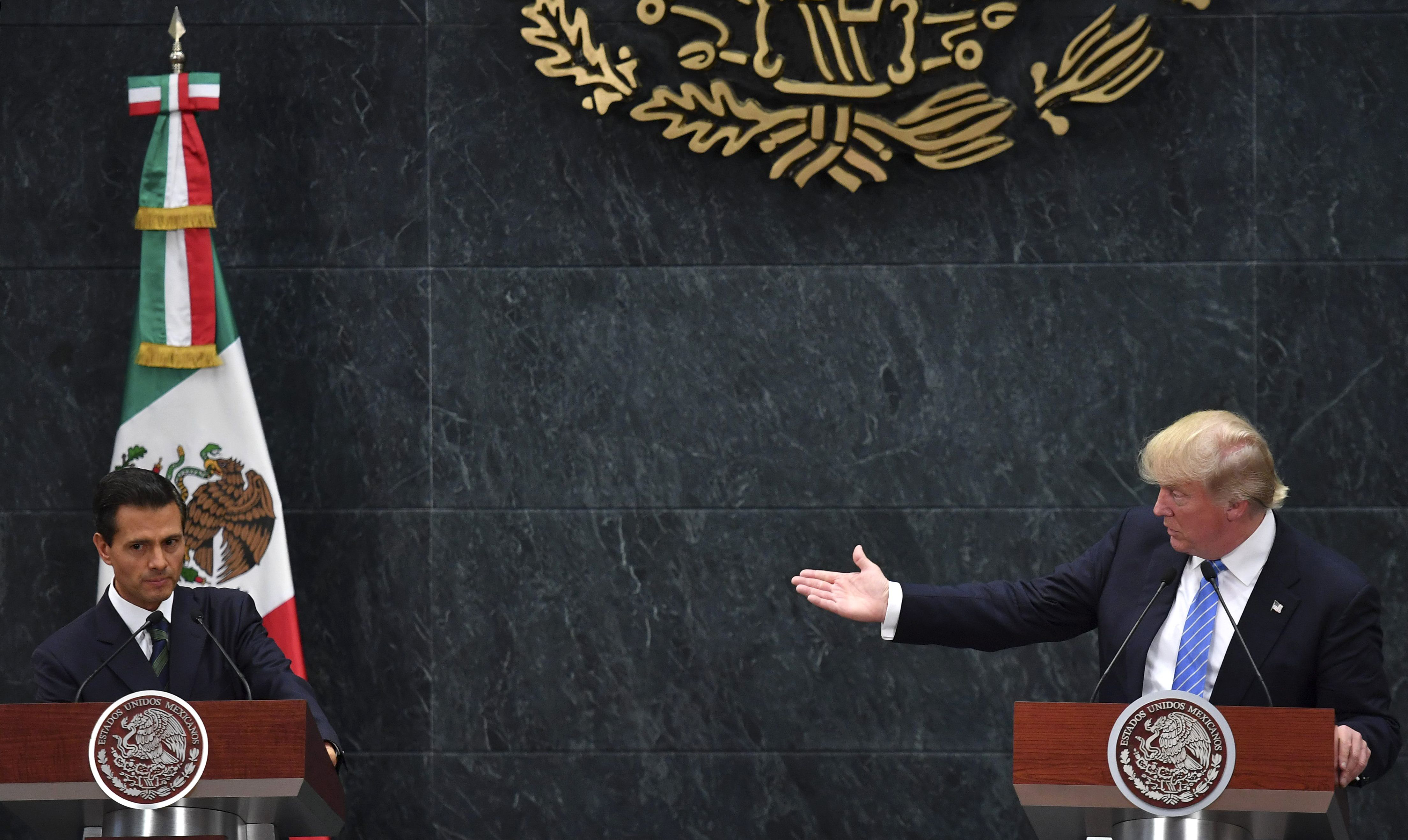 US presidential candidate Donald Trump (R) delivers a joint press conference with Mexican President Enrique Pena Nieto in Mexico City on Aug. 31, 2016.