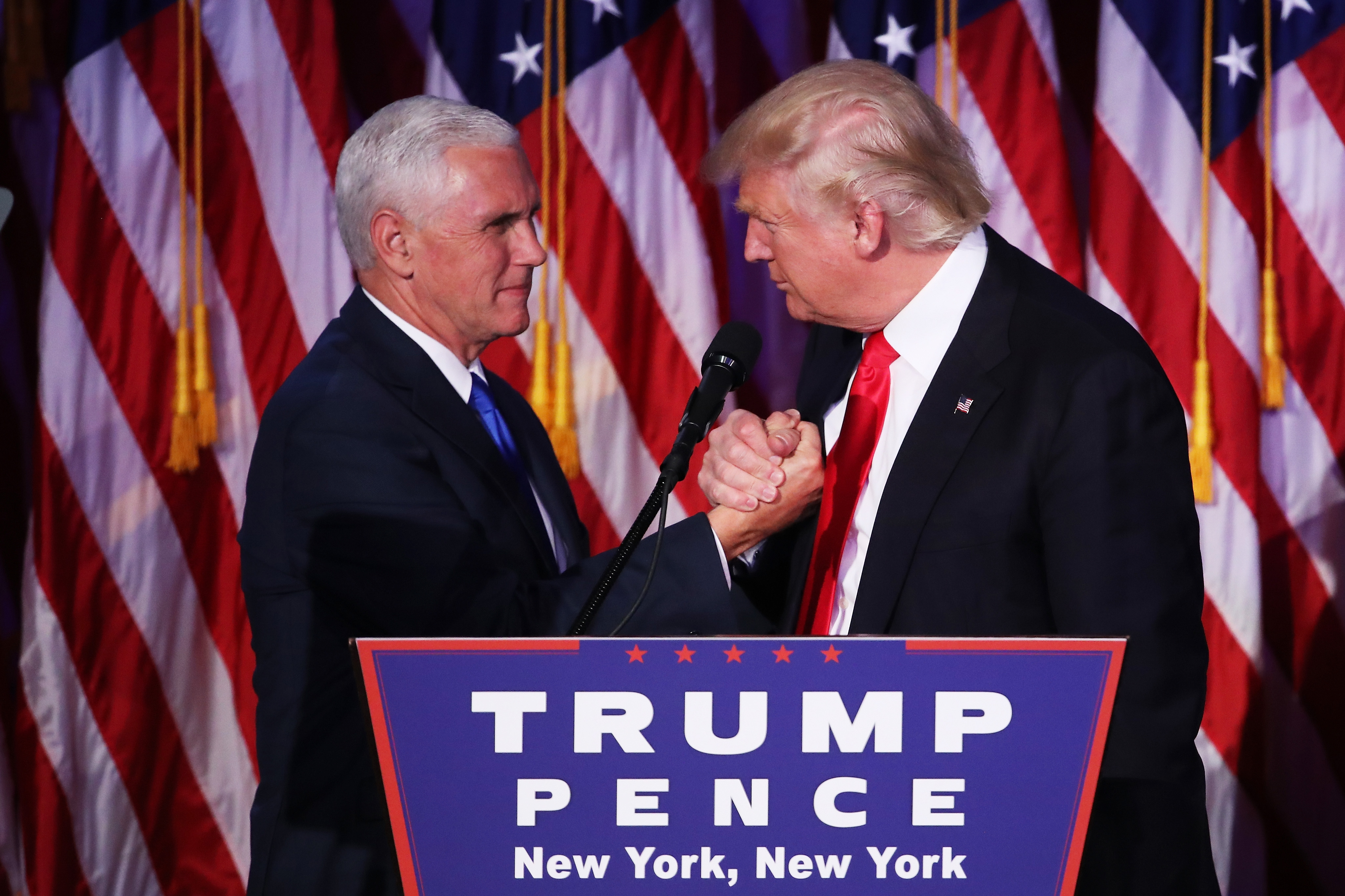 Vice president-elect Mike Pence and Republican president-elect Donald Trump shake hands during his election night event at the New York Hilton Midtown in New York City, on Nov. 9, 2016.
