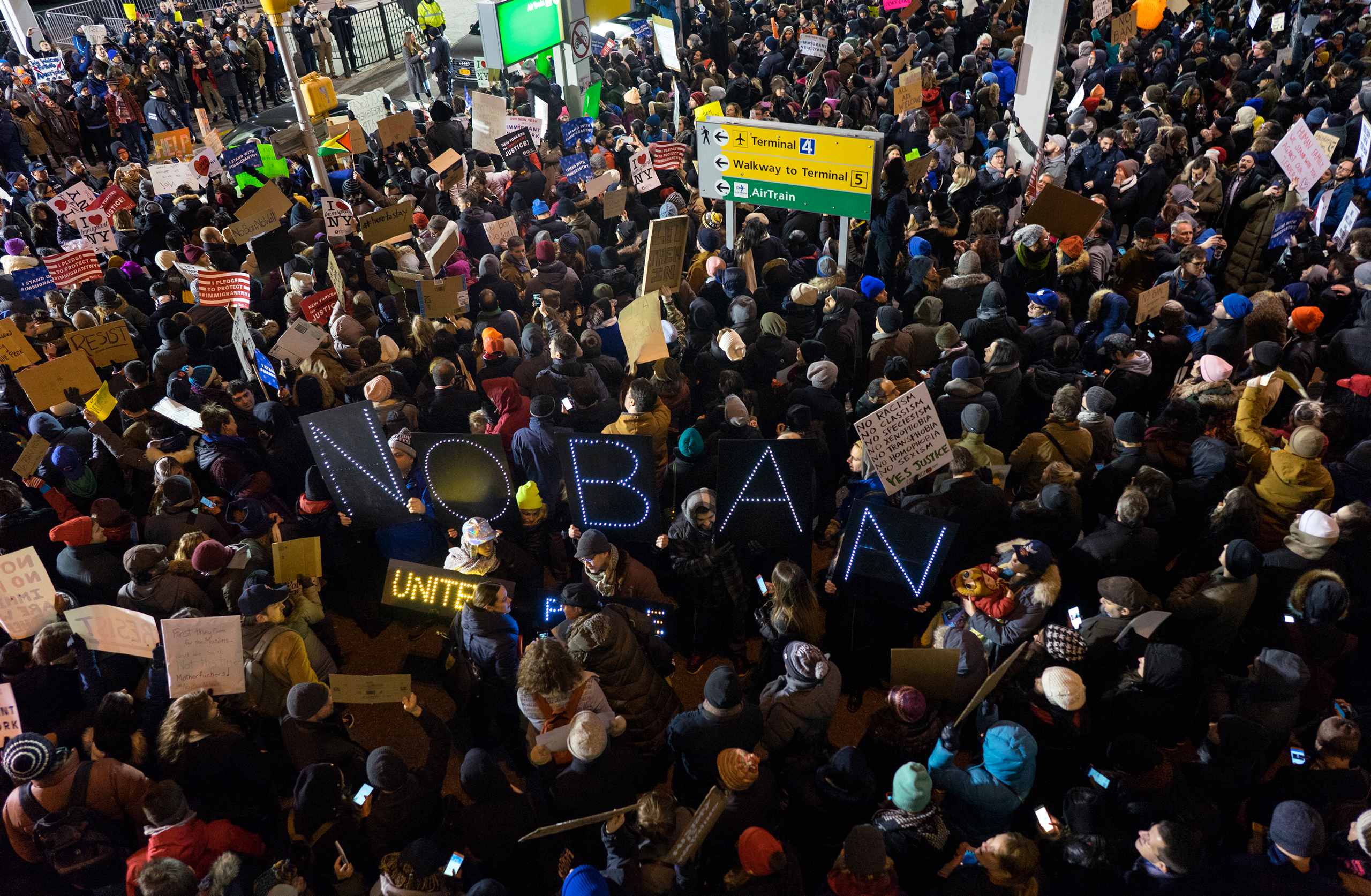 Protesters assemble at John F. Kennedy International Airport in New York on Jan. 28, 201.