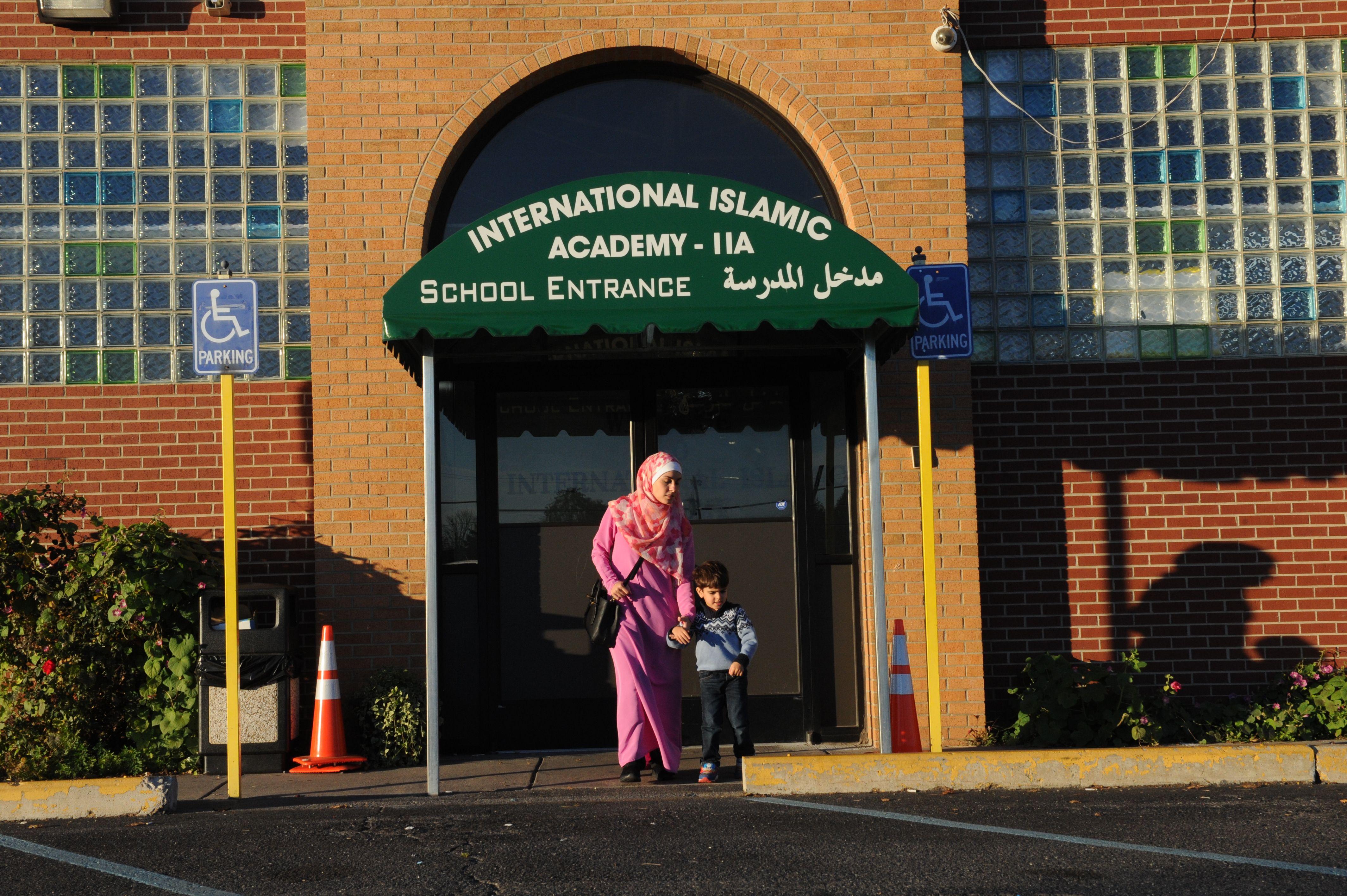 Amani Ramouni, 27, leaves the International Islamic Academy with her son Shadi, 3, in Detroit on November 9, 2016.