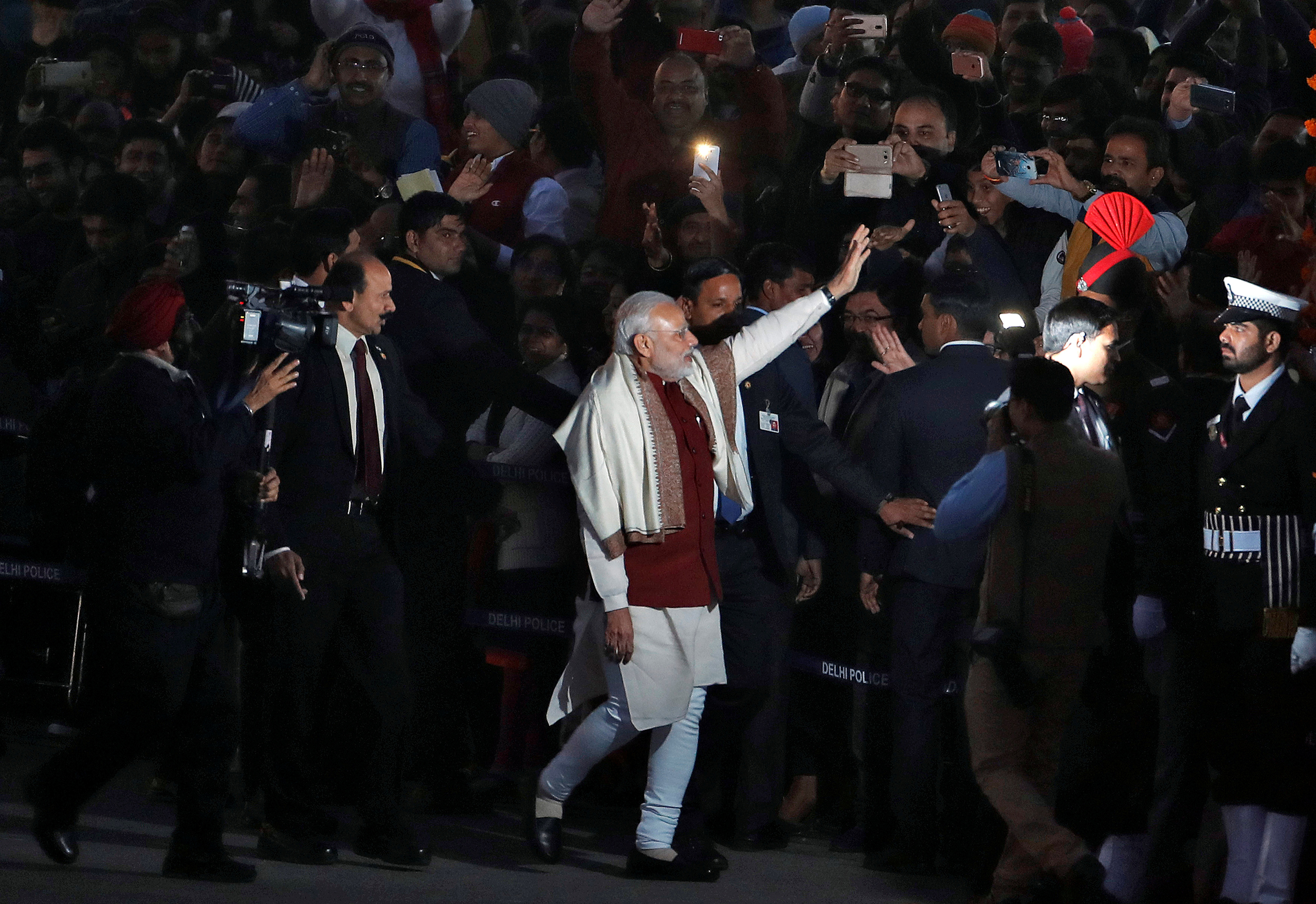 India's Prime Minister Narendra Modi waves as he leaves the Beating the Retreat ceremony in New Delhi on Jan. 29, 2017.