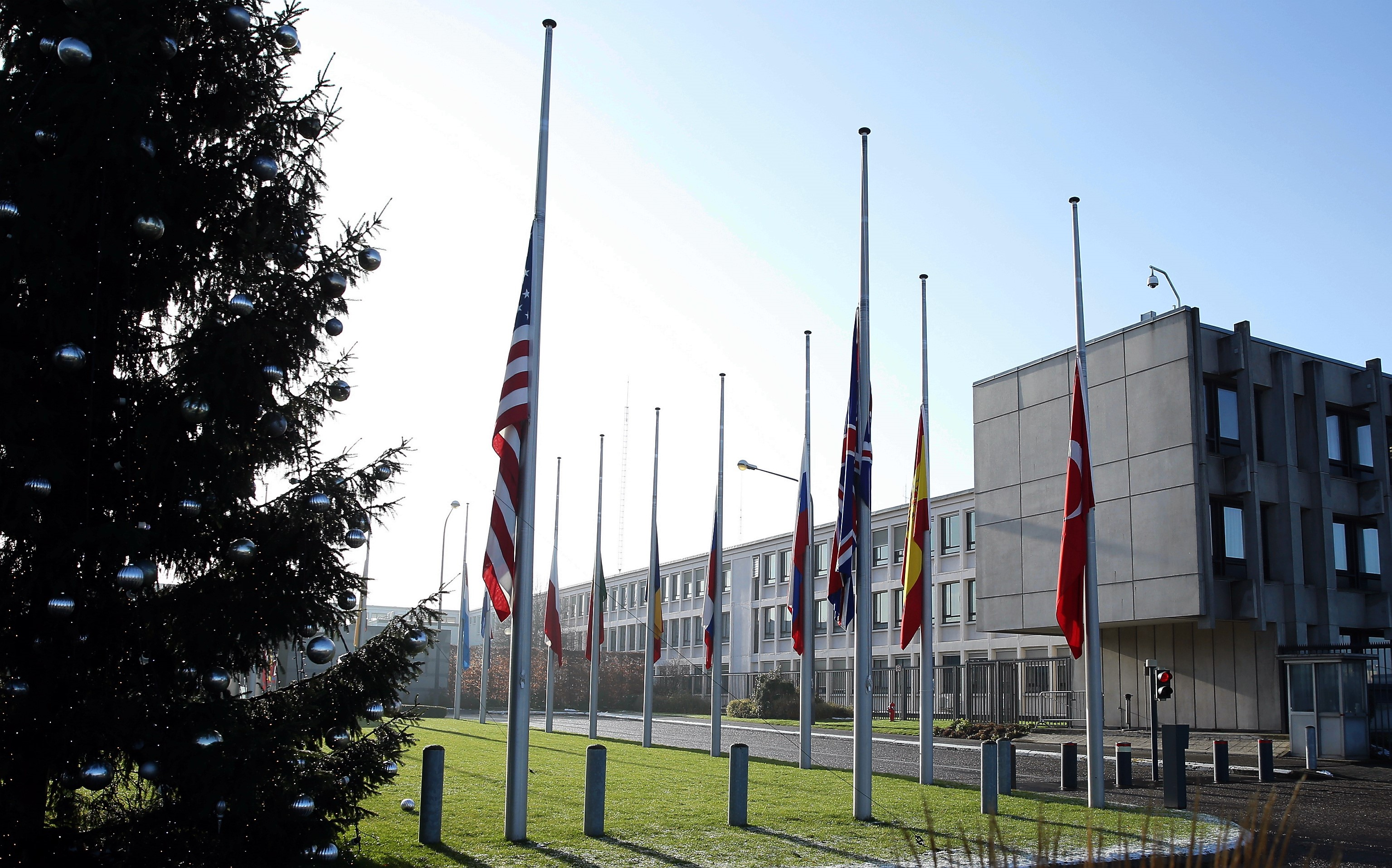 Flags of the NATO member countries fly at half-mast at NATO Headquarters in Brussels, Belgium on January 2, 2017, due to terror attack at a nightclub in Istanbul.