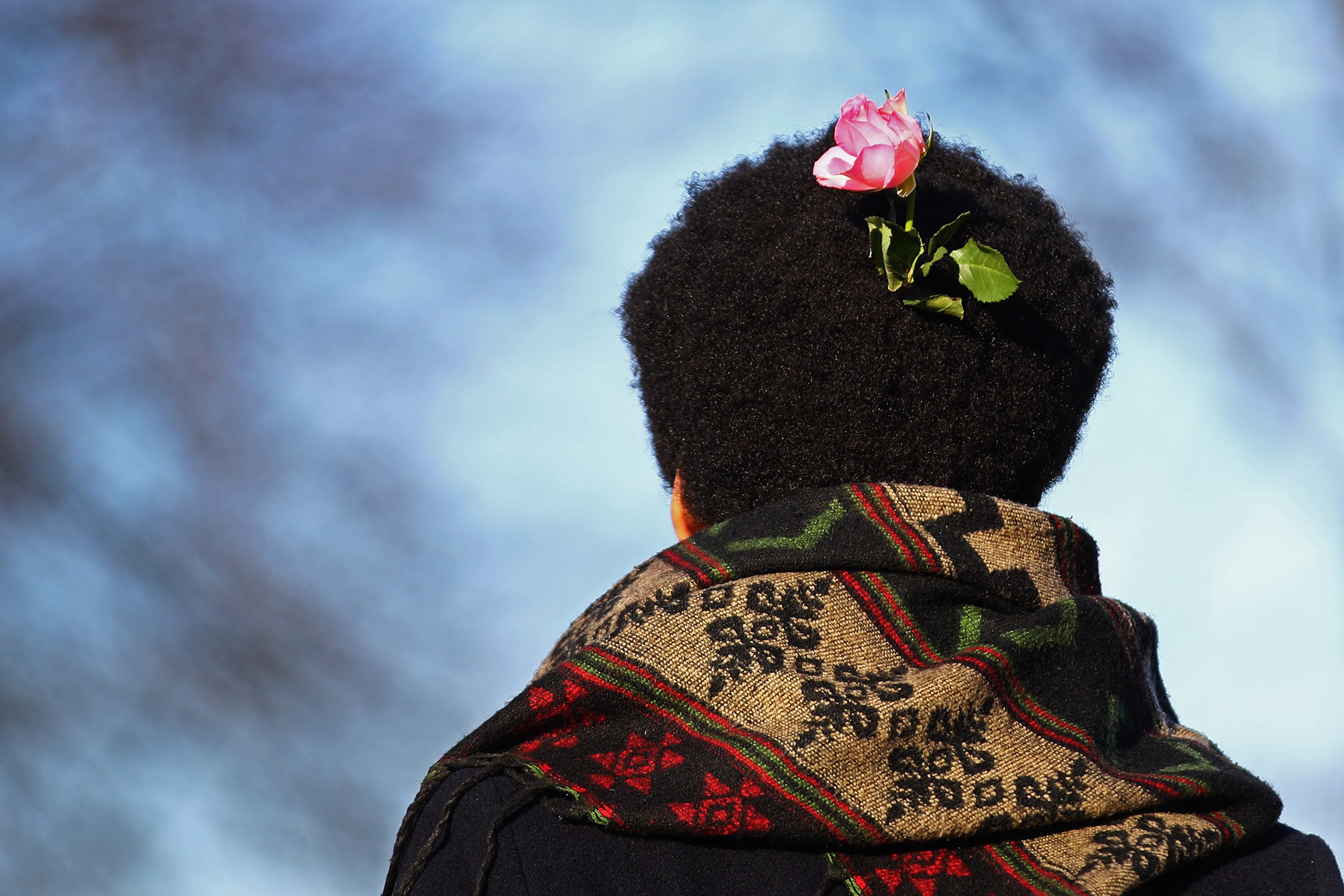 A demonstrator with a pink flower in his hair joins the crowd as they make their way towards the US Consulate during the Women's March held at Museumplein on Jan. 21, 2017 in Amsterdam, Netherlands.