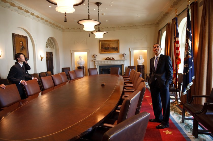 President Barack Obama surveys the Cabinet room with family members while touring the White House on his first day in office.