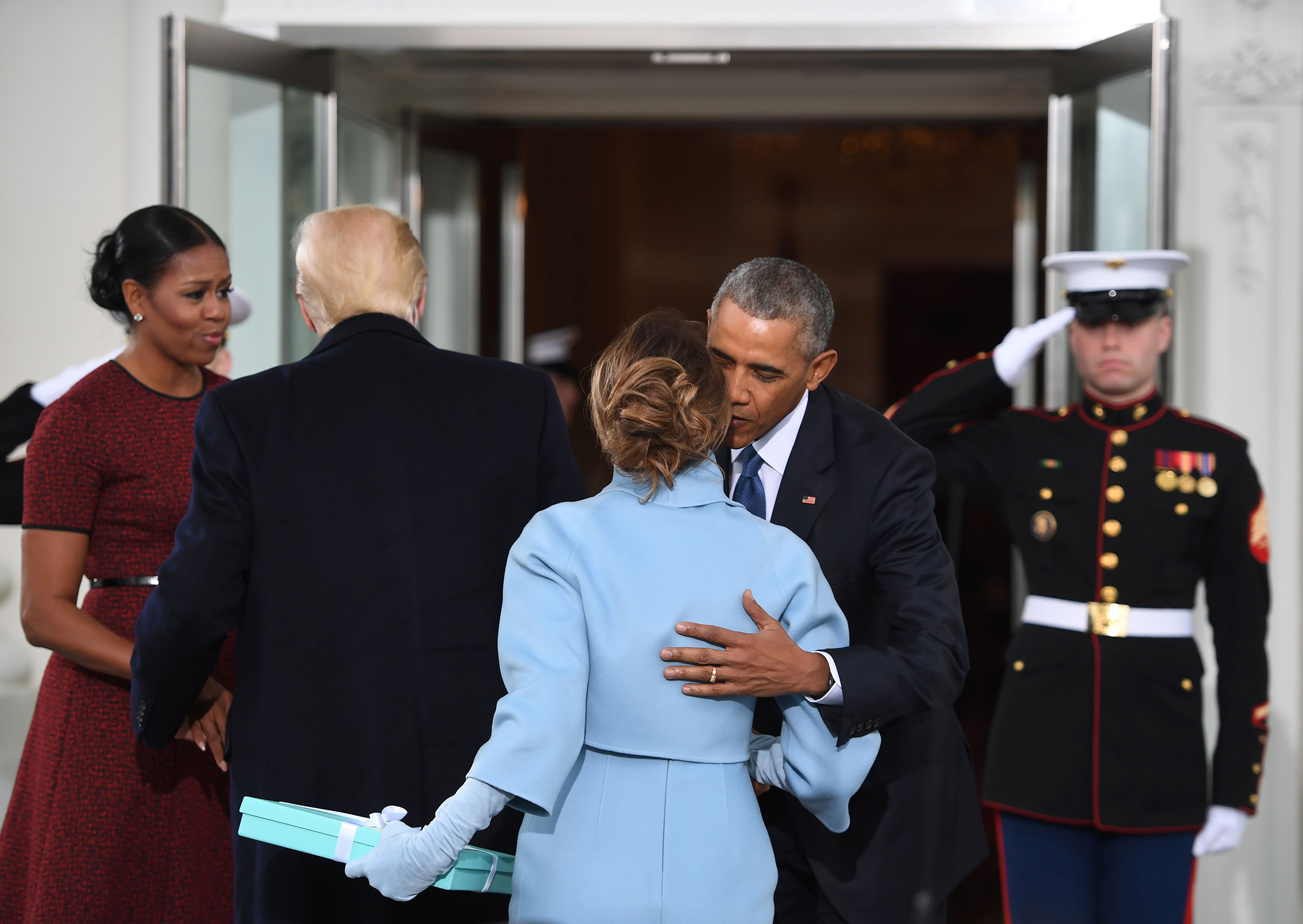 Melania Trump, bearing a gift from Tiffany & Co., greets President Obama before President Trump's swearing-in ceremony.