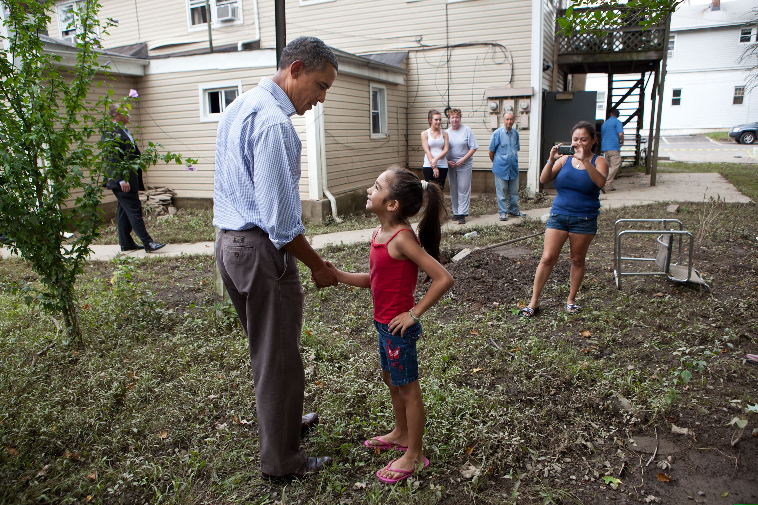 Obama greets a girl while touring a neighborhood affected by Hurricane Irene in Wayne, New Jersey on Sept. 4, 2011.