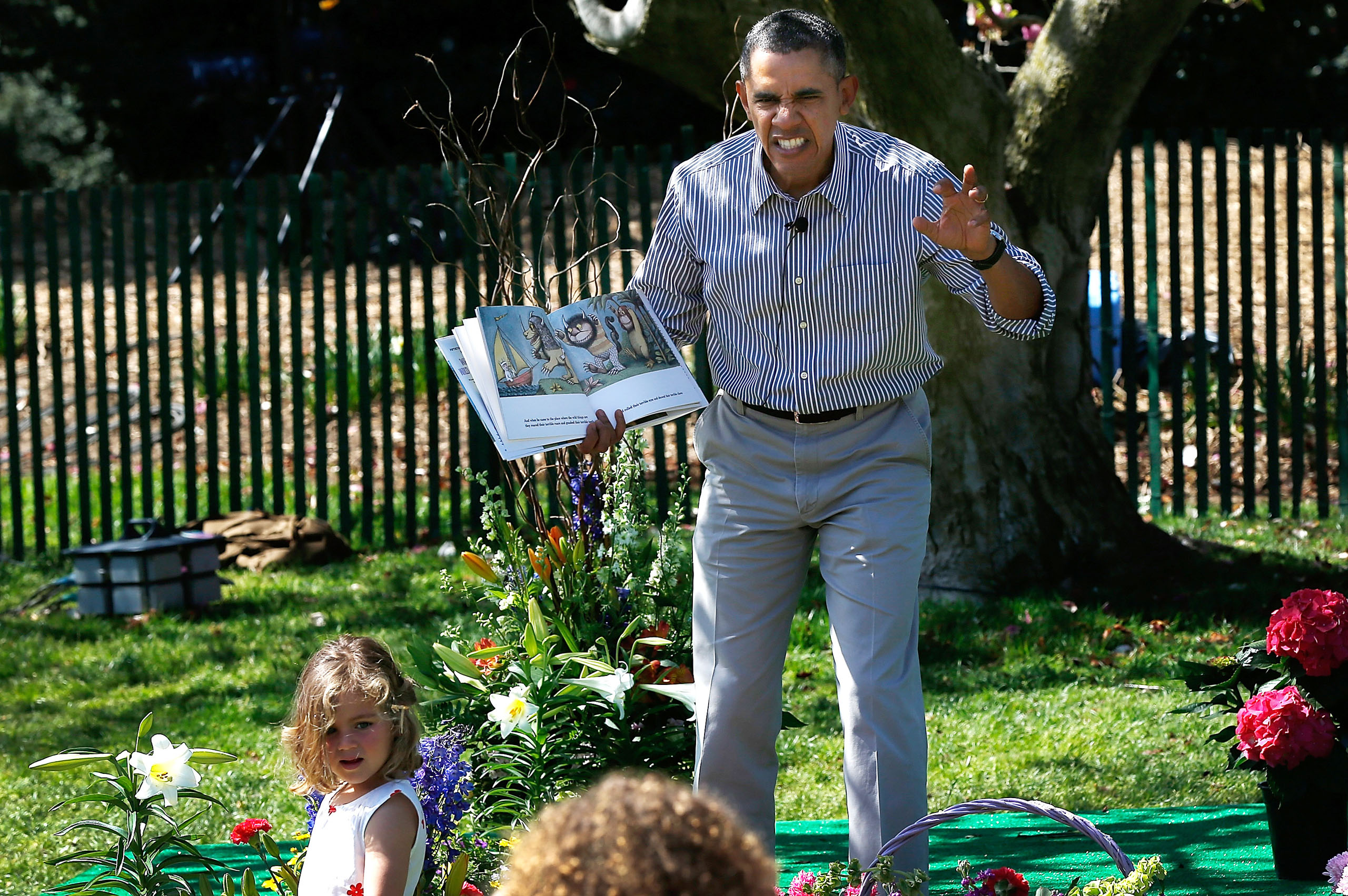 Obama read to children from the book  Where the Wild Things Are  during the annual White House Easter Egg Roll on the South Lawn in Washington, DC, on April 21, 2014.