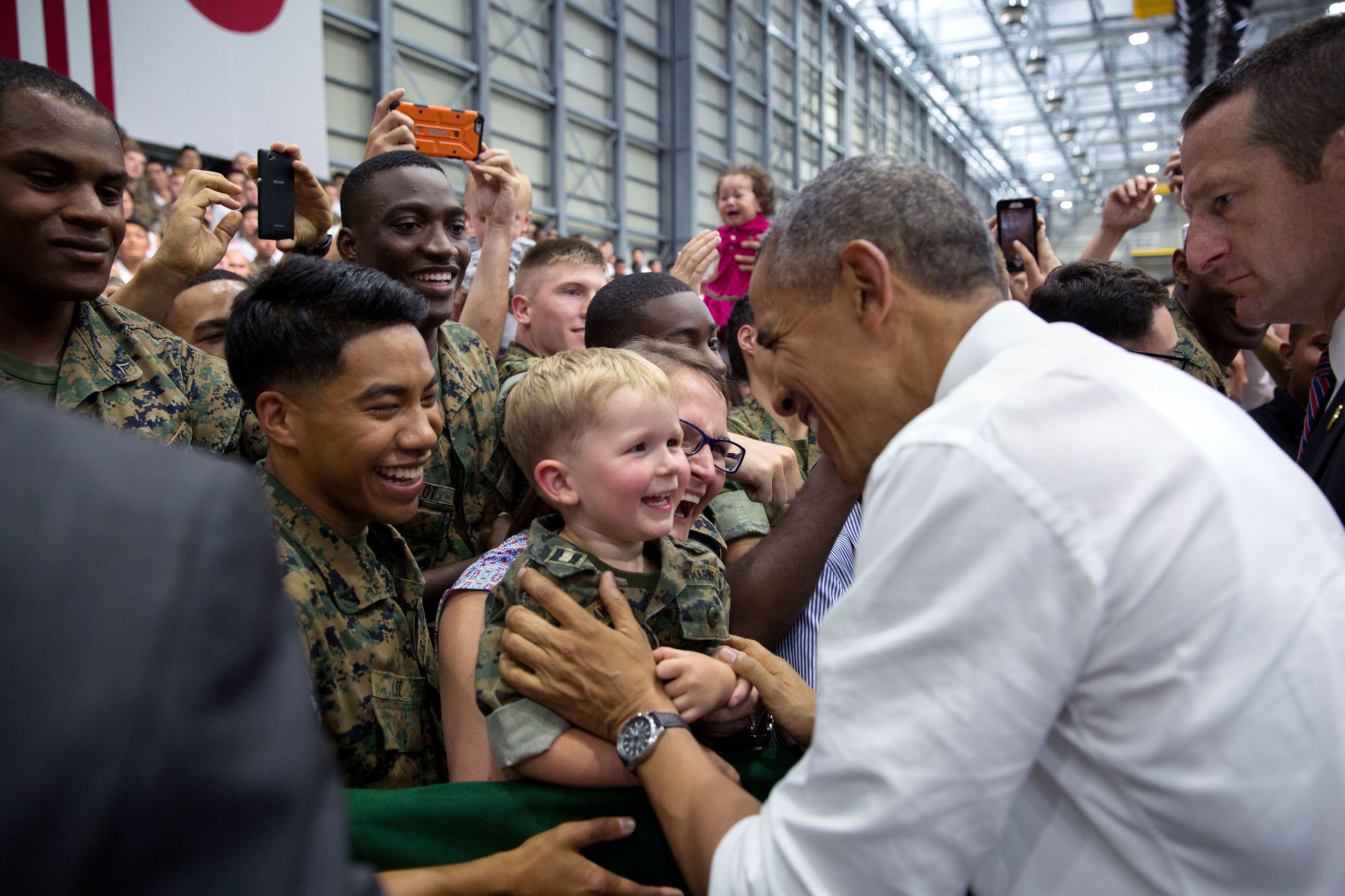 Obama gets a smile from a young boy as he greets audience members after remarks at Marine Corps Air Station at Iwakuni, Japan, on May 27, 2016.