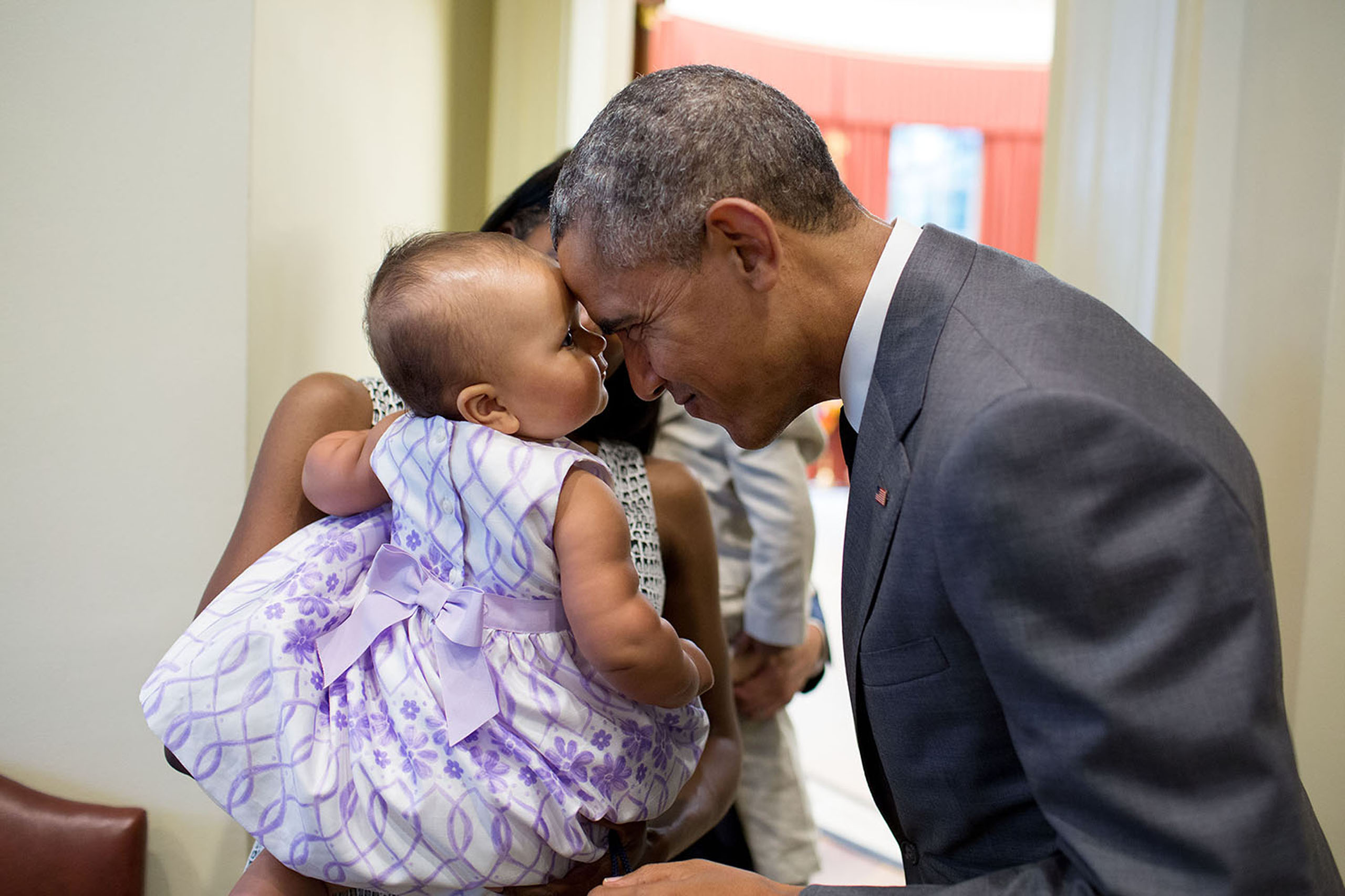 The President greets nine-month-old Josephine Gronniger, whose father, Tim Gronniger, brought his family by the Oval Office for a family photo on July 17, 2015.