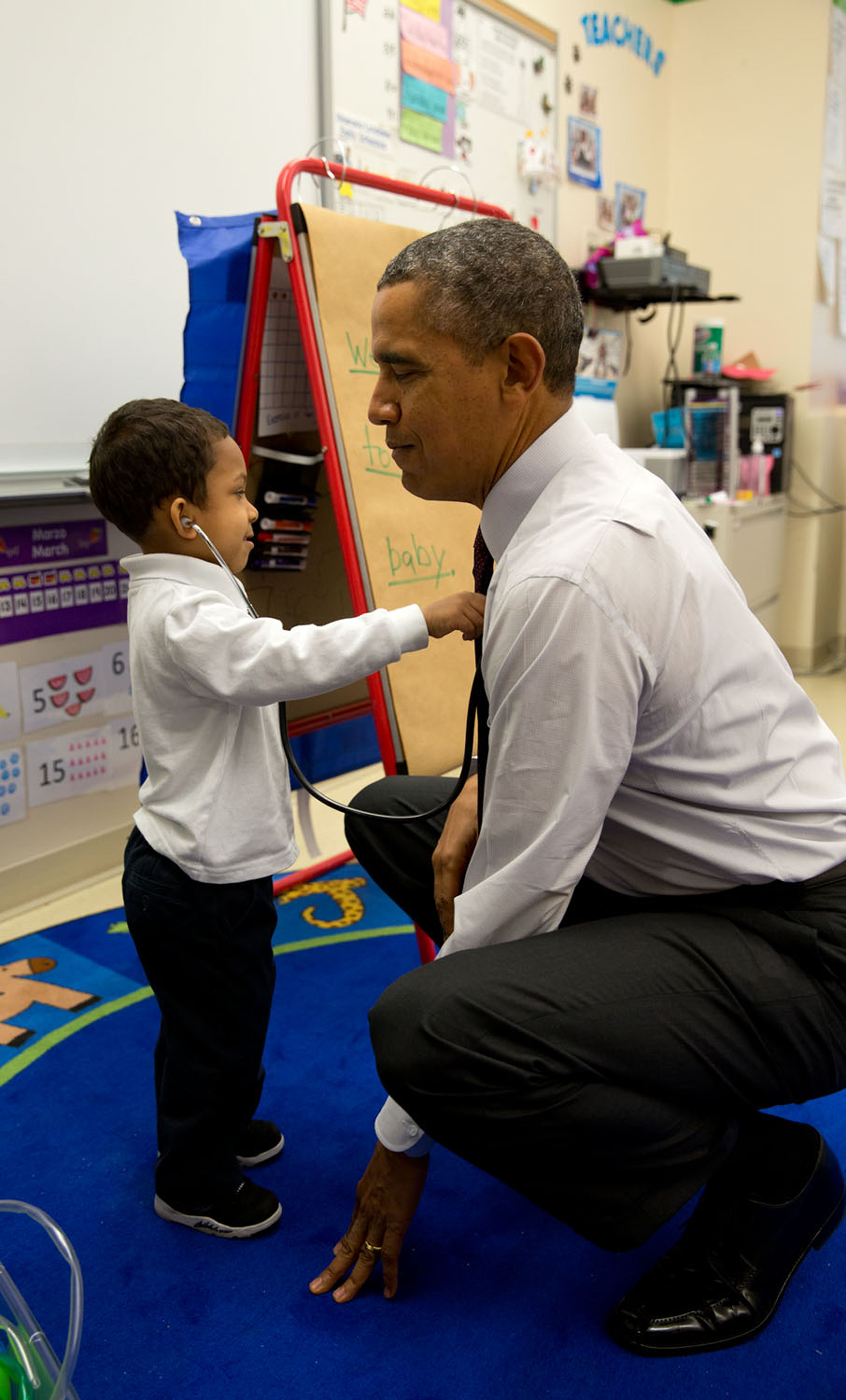 Obama asks a student at Powell Elementary School to check his heartbeat with a stethoscope in Washington, D.C., on March 4, 2014.