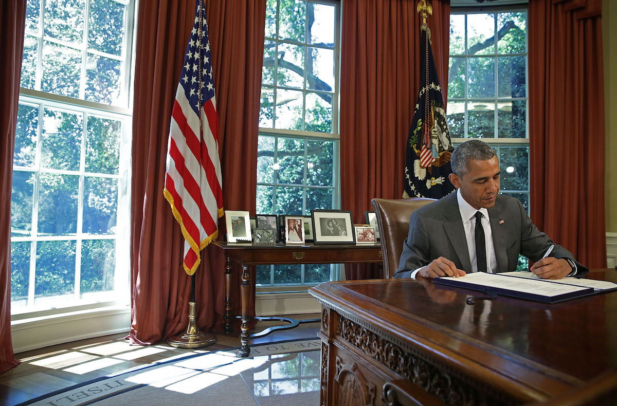 President Barack Obama signs a bill in the Oval Office of the White House, July 31, 2015 in Washington, D.C.