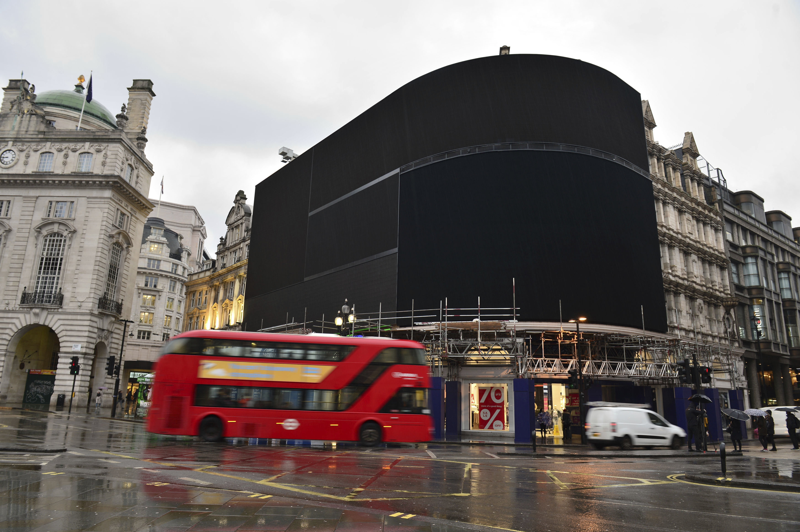 The advertising screens at Piccadilly Circus, central London, after they were switched off in preparation for redevelopment on Jan.  16, 2017.